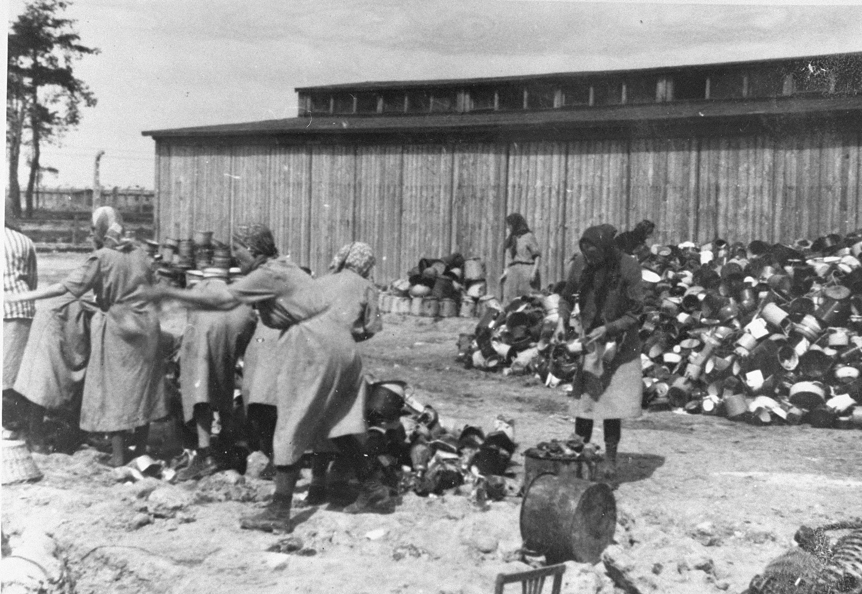 "Prisoners in the Aufräumungskommando (order commandos) sort the confiscated property of a transport of Jews from Subcarpathian Rus at a warehouse in Auschwitz-Birkenau.  The camp prisoners came to refer to the looted property as ""Canada,"" associating it with the riches symbolized by Canada.  The members of this commando were almost exclusively Jews.  ""Canada"" storage facilities occupied several dozen barracks and other buildings around the camp.  The looted property was funneled from Auschwitz through an extensive distribution network that served many individuals and various economic branches of the Third Reich."