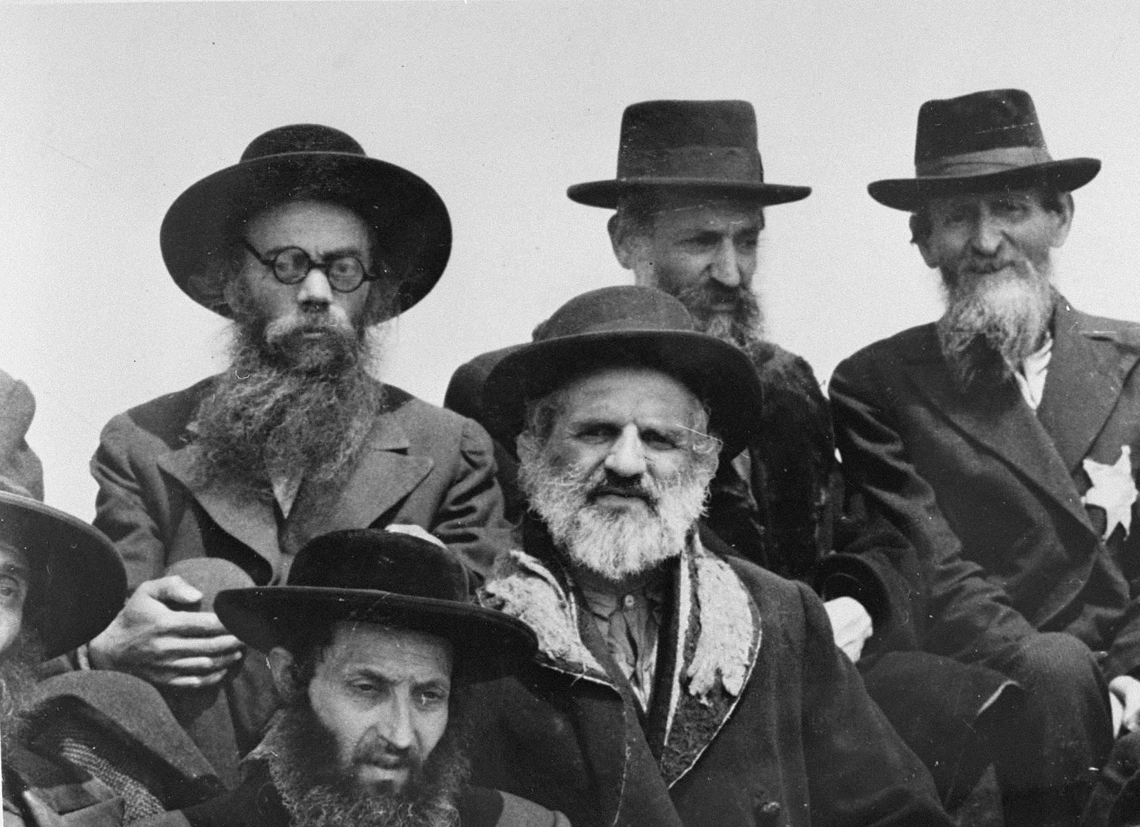 A group of religious Jews from Subcarpathian Rus wait on the ramp at Auschwitz-Birkenau.