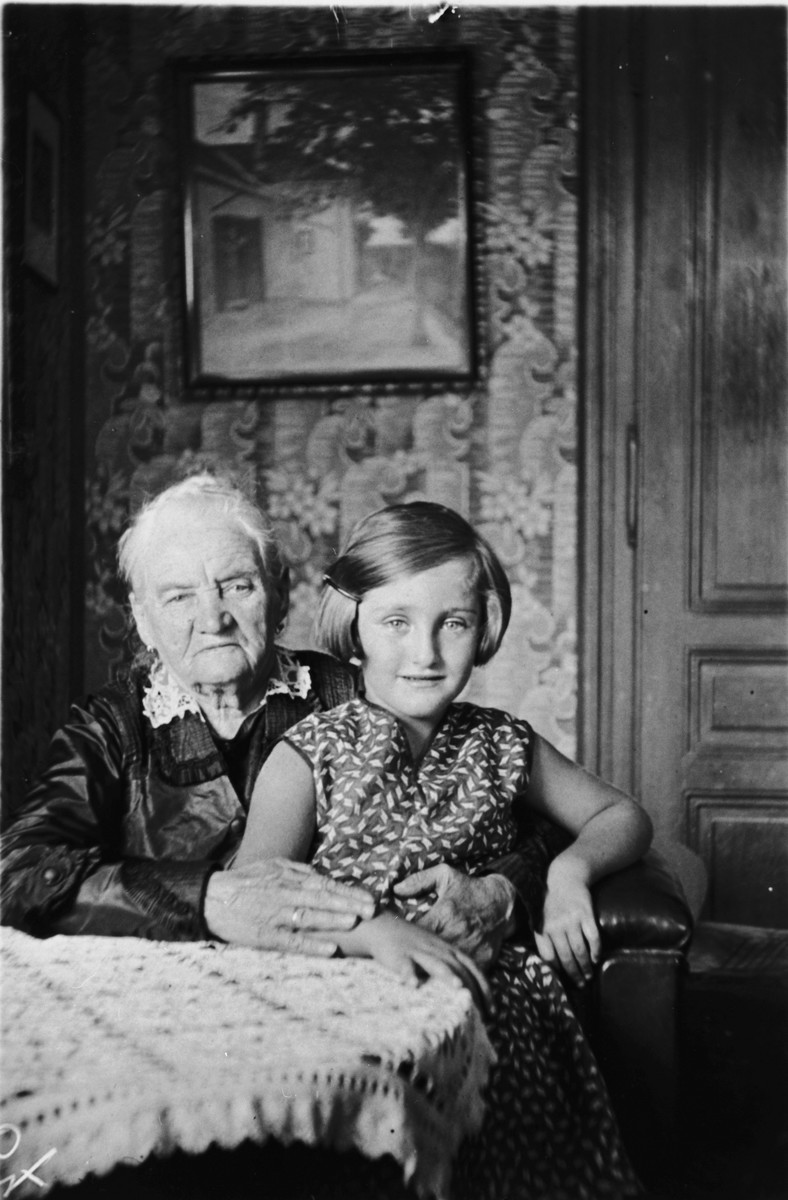 Ilse Morgenstern poses on her grandmother's lap inside their home in Vienna.