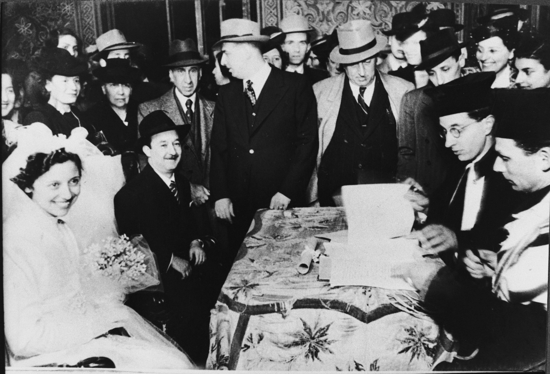 Rabbi Nathan Cassuto officiates at a wedding in Florence.  Also pictured is Rabbi Fernando Belgrado, later Chief Rabbi of Florence.