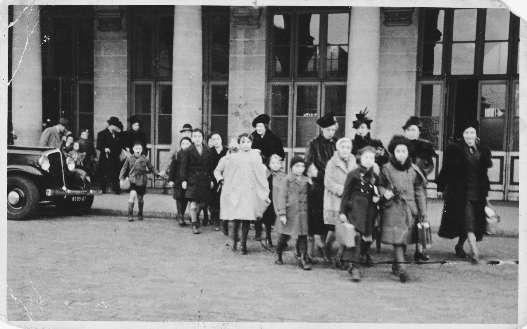 Bertha Marx accompanies a group of Jewish refugee children, including her son Ernest, who have just arrived in Paris on a Kindertransport from Germany.