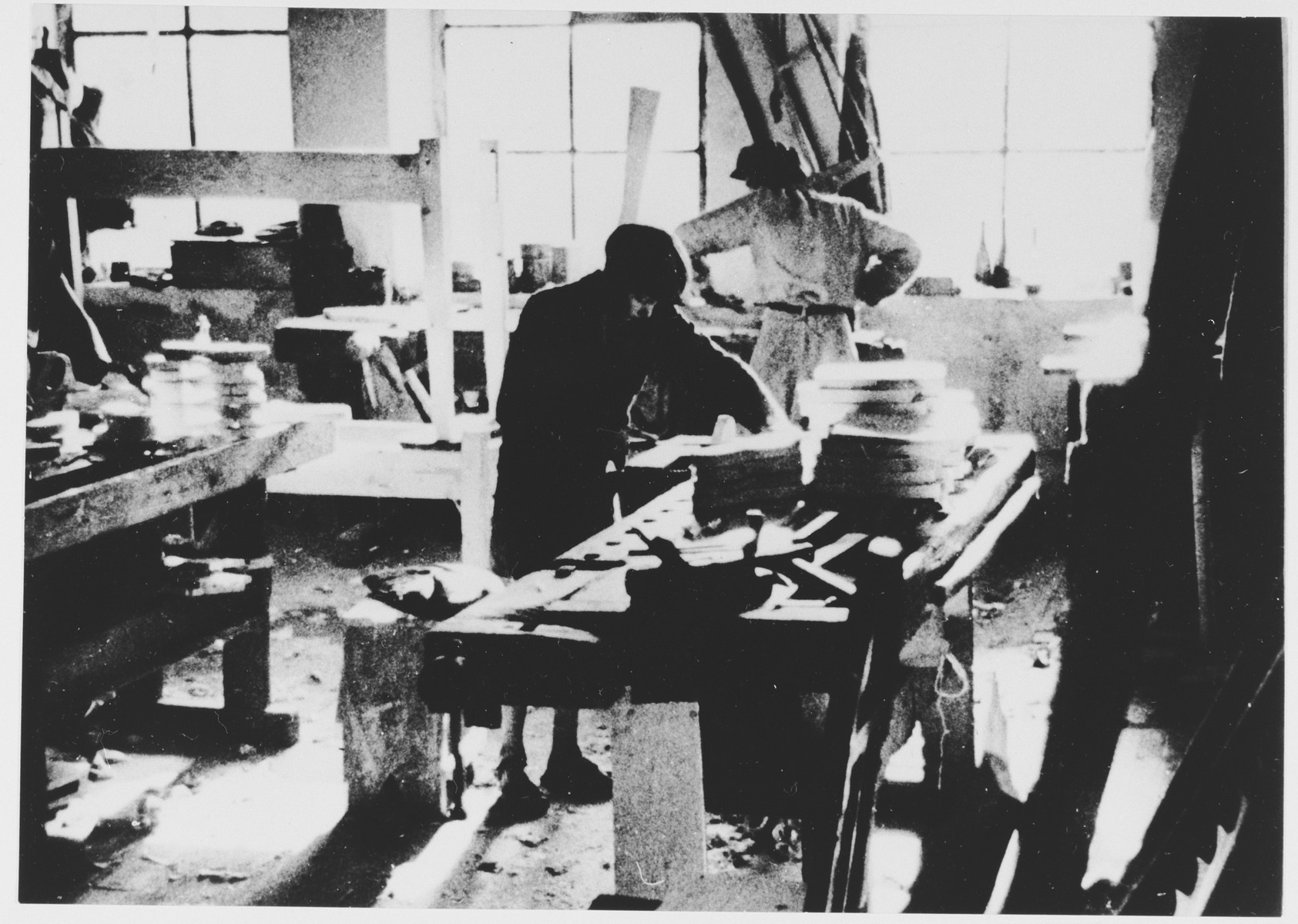 Prisoners labor in a saddle-making workshop in the Jasenovac III concentration camp.  This photograph was used for propagandistic purposes by the Ustasa.