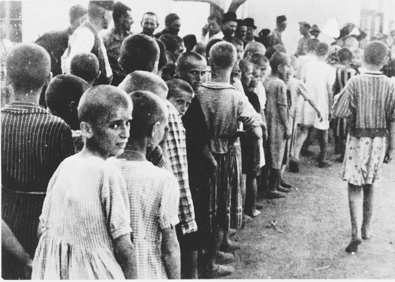 A group of children wait in line at an unidentified concentration camp in Croatia.