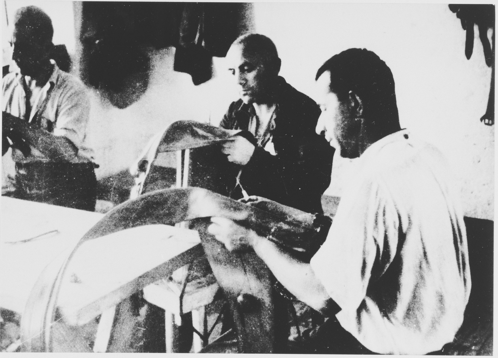 Prisoners labor in a tailoring workshop in the Stara Gradiska concentration camp.  This photograph was used for propagandistic purposes by the Ustasa.