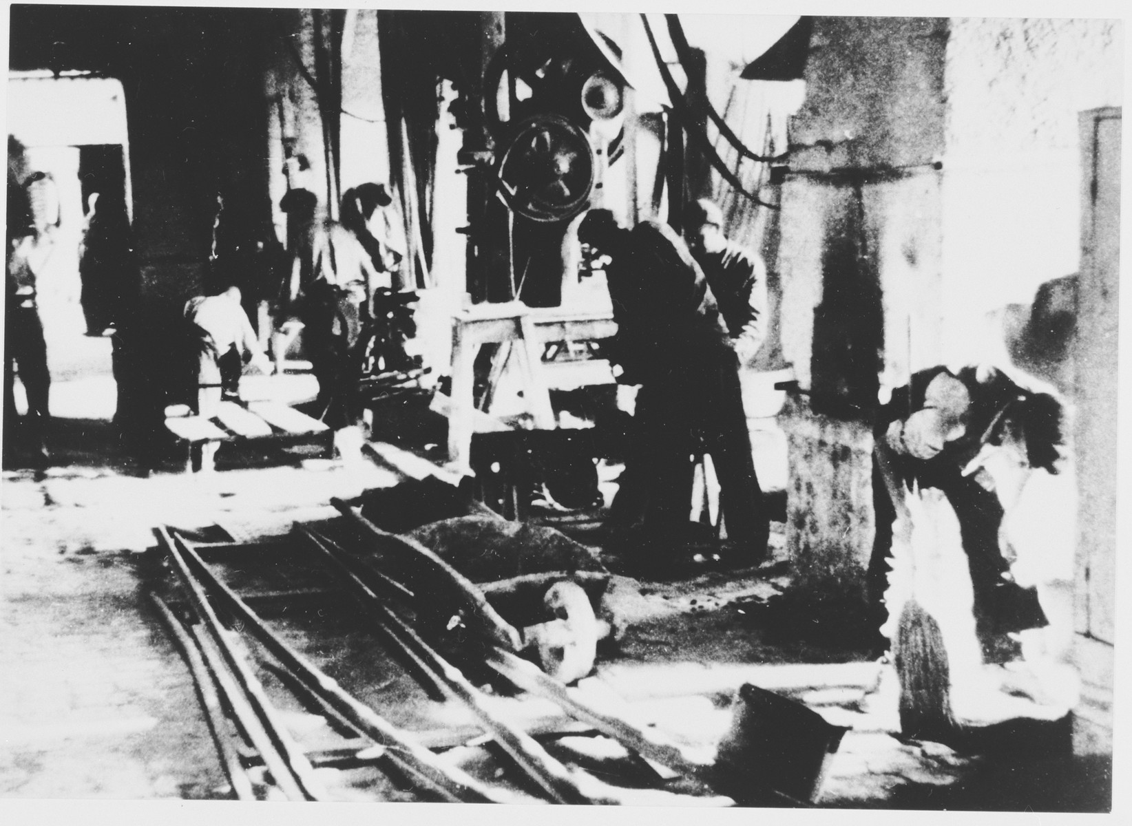 Prisoners labor in a workshop in the Jasenovac III concentration camp.  This photograph was used for propagandistic purposes by the Ustasa.