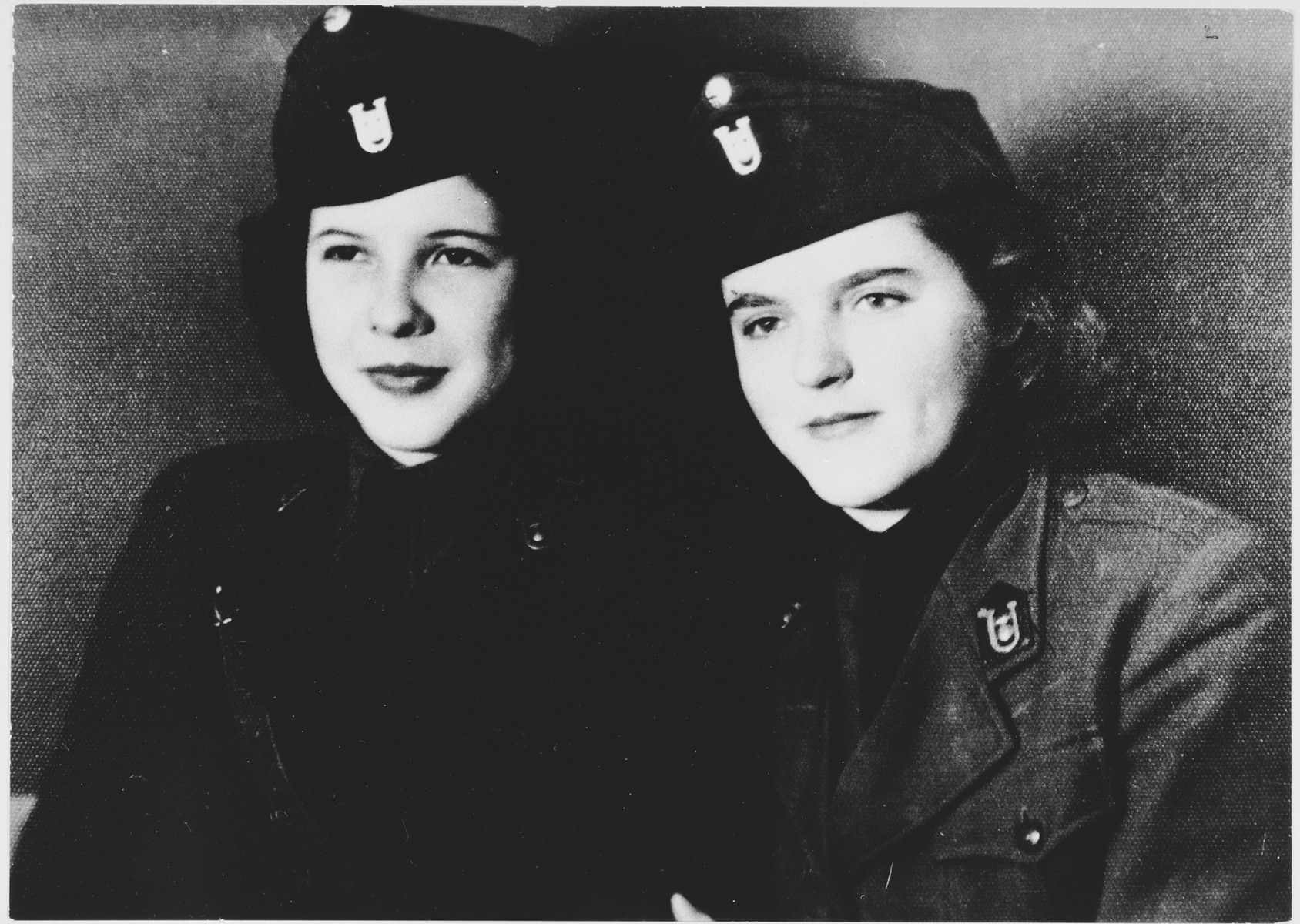 Portrait of two young women in Ustasa uniform.  Pictured on the left is Nada Tanic-Luburic and on the right is Maja Slomic-Buzdon.