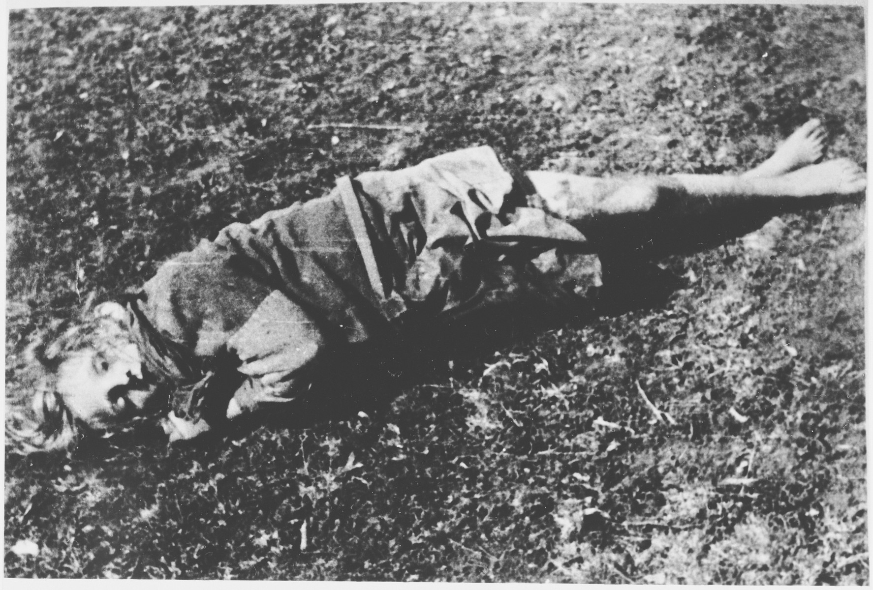 The body of a little girl lies on the ground at the Gradina execution site near the Jasenovac concentration camp.