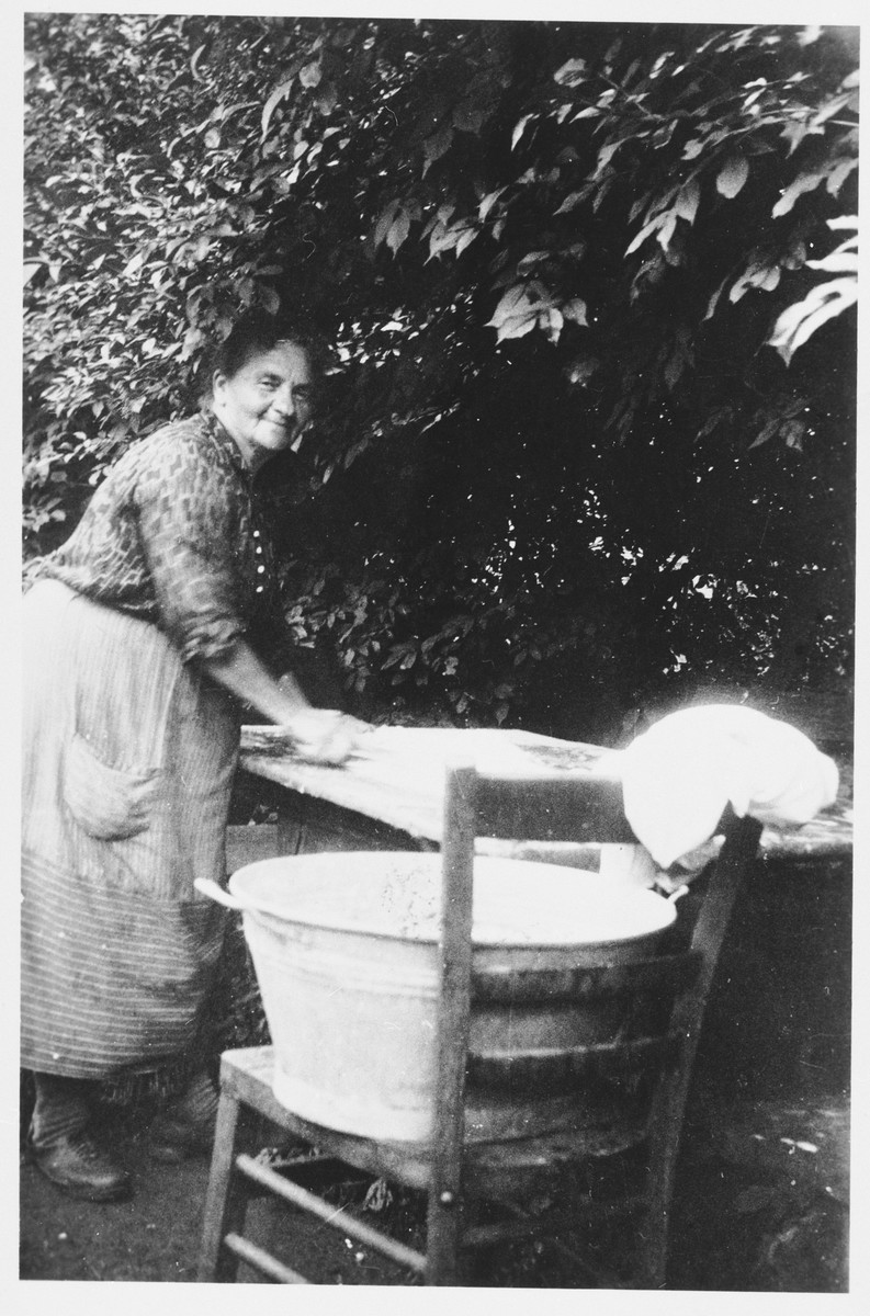 Hedwig Winter washes laundry outside her home in Wittelshofen, Germany.