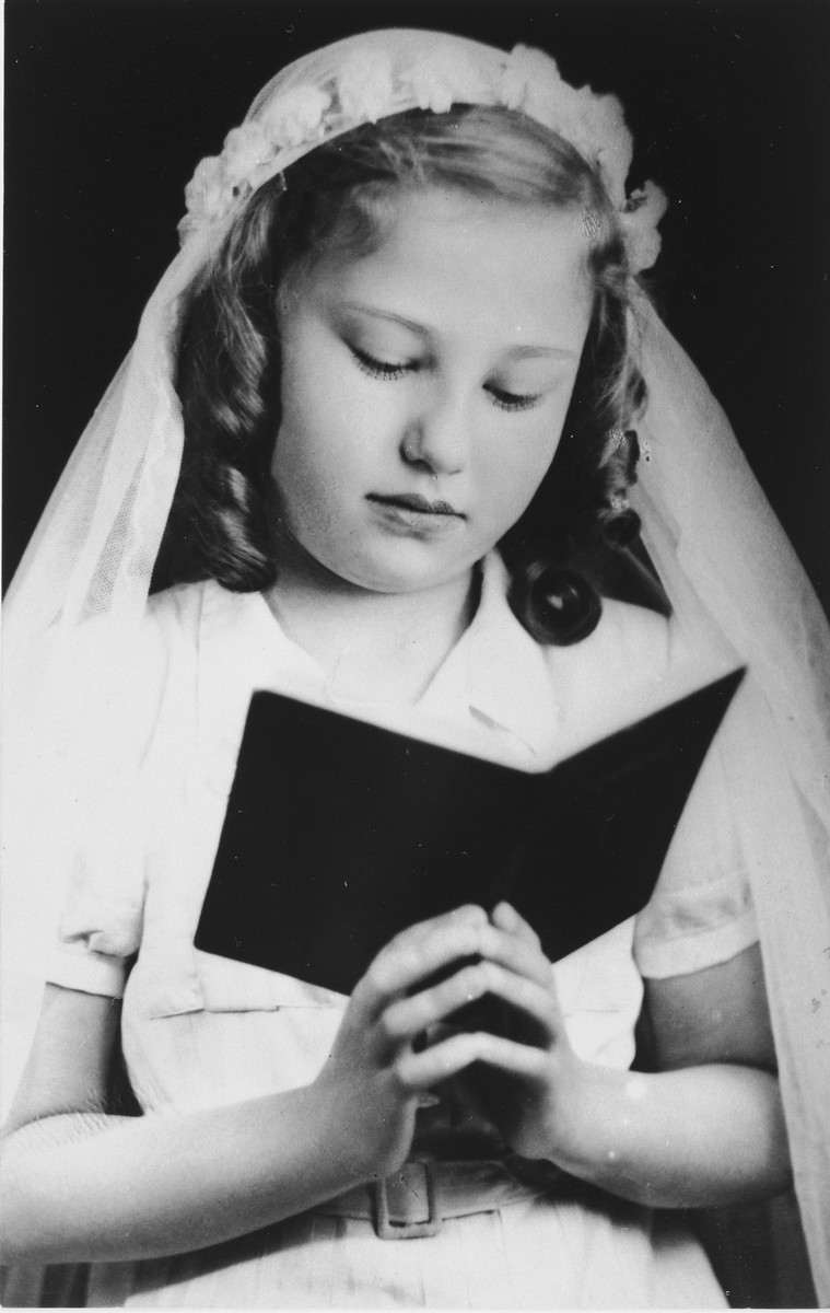 First communion portrait of Judit Schichtanz.    This photo was later used as proof of her Christian identity while she was living in hiding in Budapest.