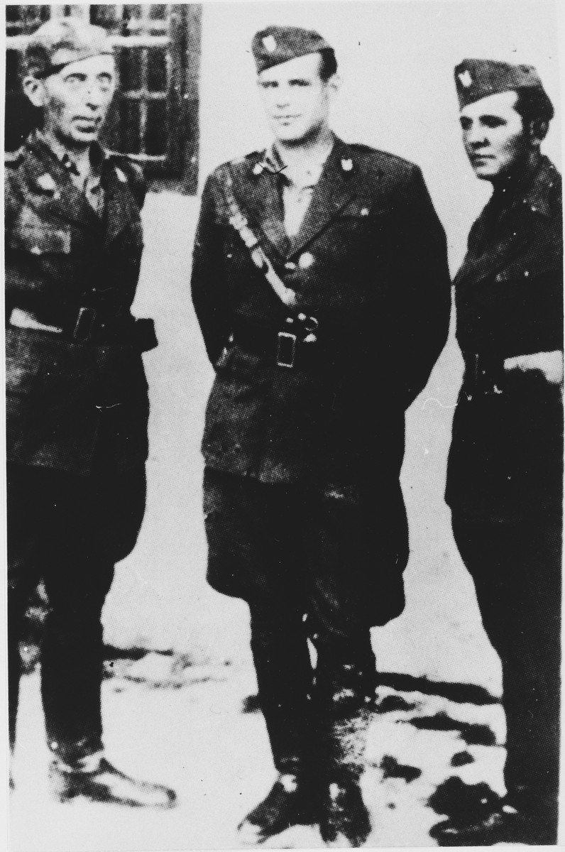 Miroslav Filipovic-Majstorovic (center) poses with two Ustasa guards at the Jasenovac concentration camp.