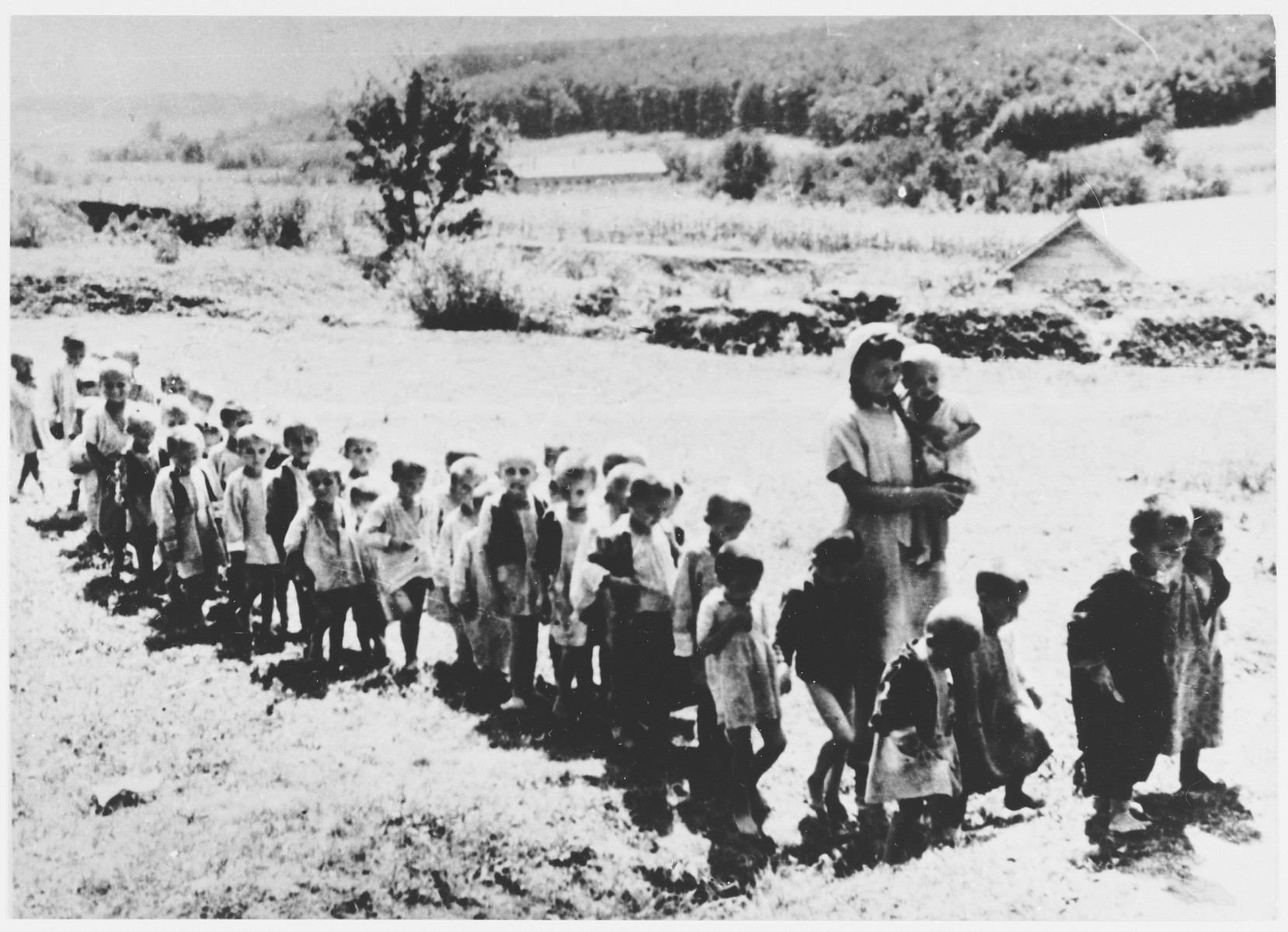 [Possibly a group of Serbian children being marched to a concentration camp].