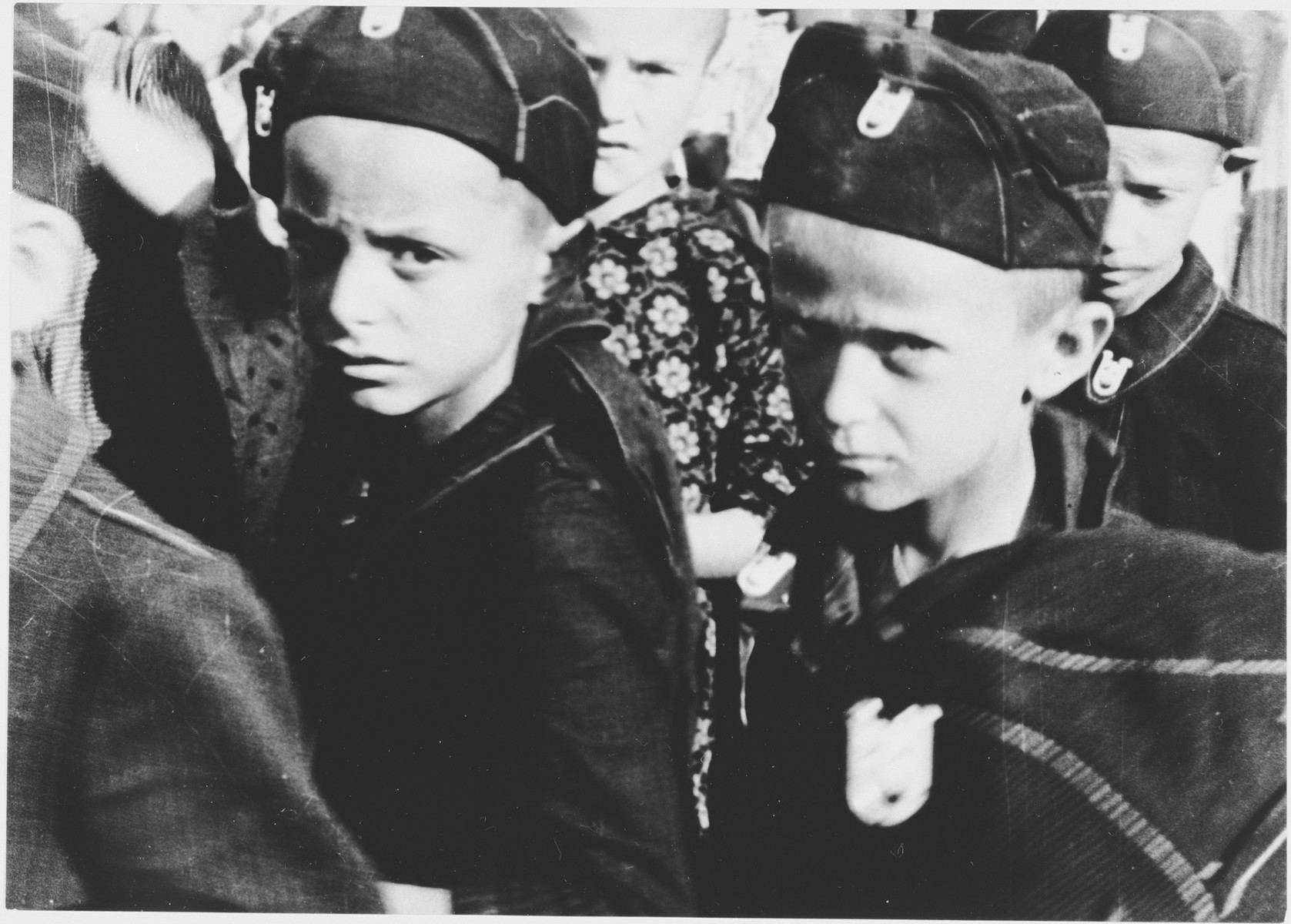 Serbian boys dressed in Ustasa uniforms are assembled in the Stara Gradiska concentration camp.  The children were called Lubruric's Little Serbs after Maks Lubruric, the commandant of the Jasenovac concentration camp.  Dressing the imprisoned children in Ustasa uniforms was part of the Croatian regime's effort to reeducate the Serbian boys from the Kozara region.