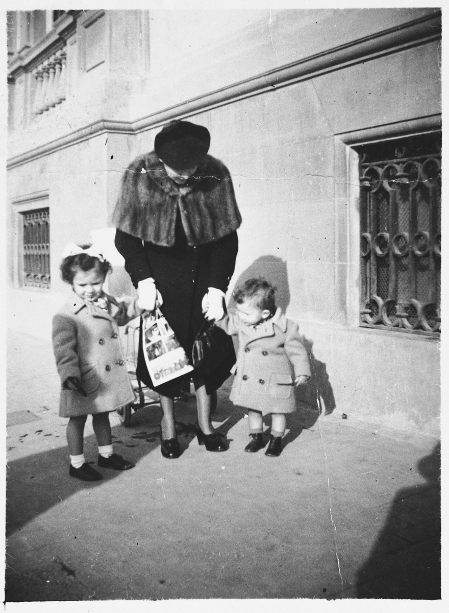 Anna Cassuto stands on a sidewalk in Florence with her children Susanna and David.