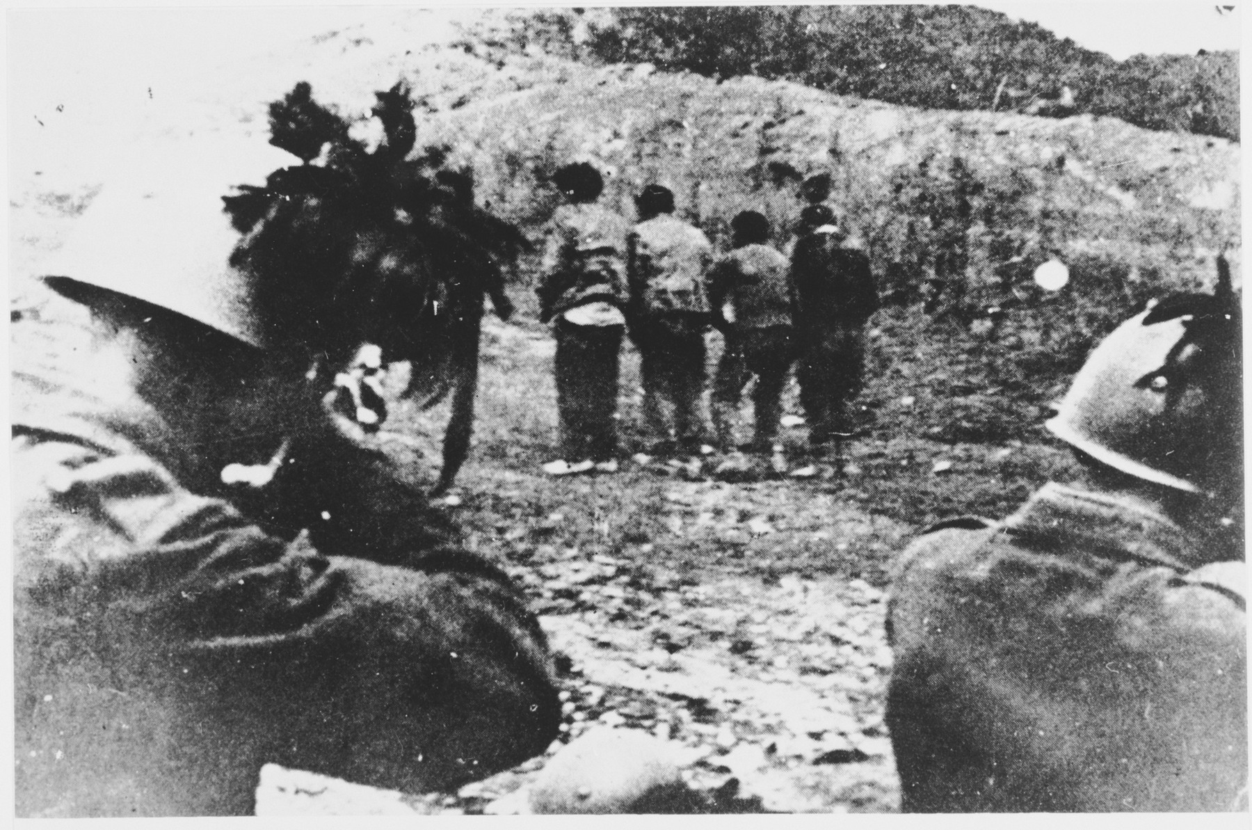 Italian soldiers take aim at a group of unidentified prisoners they are about to shoot.