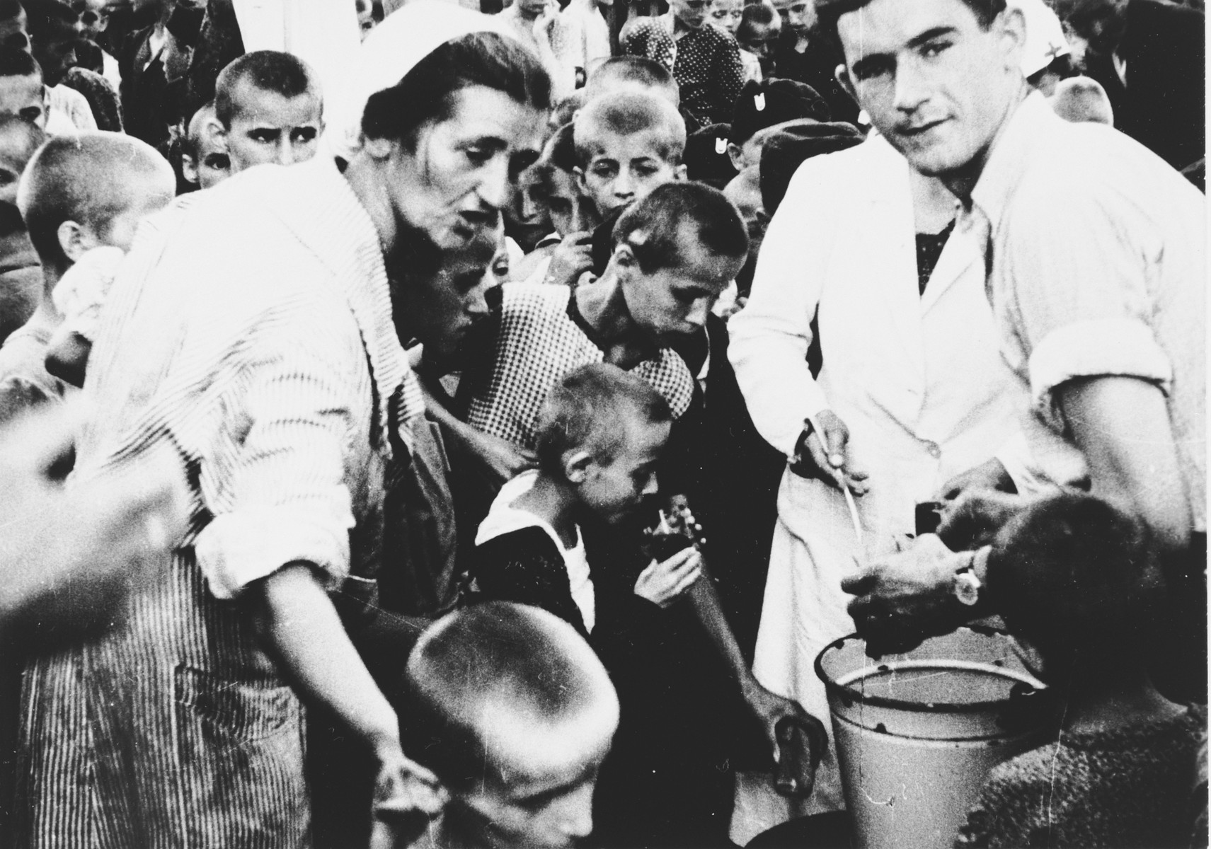 Children are led through a registration process at the Stara Gradiska concentration camp before being transported to Zagreb.