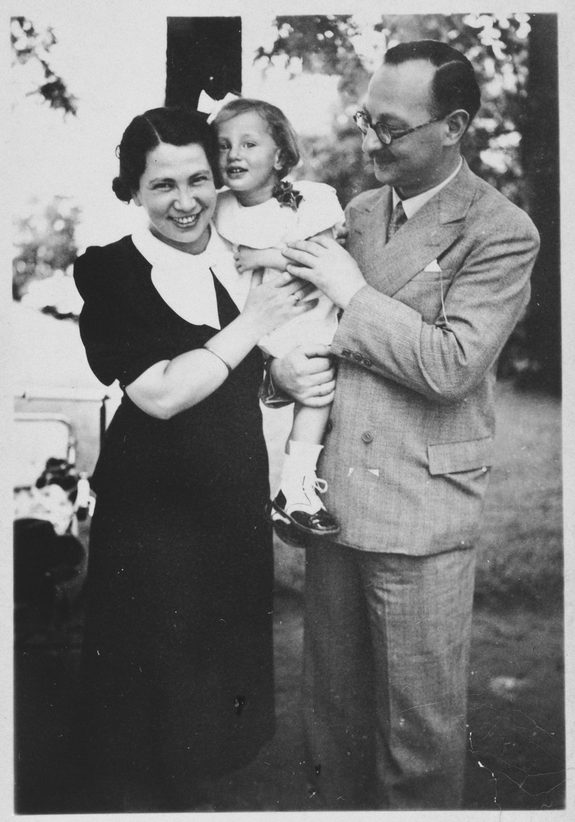 Portrait of a Jewish family in Budapest.  Pictured are Lorand and Ella Schichtanz with their daughter, Judit.