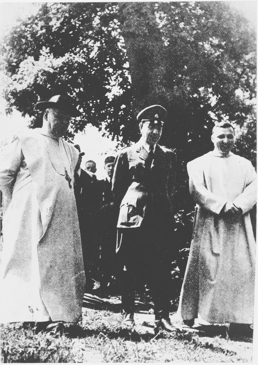 Ante Pavelic (center) stands with Giuseppe Ramiro Marcone (left) and Marrussio (?) at a ceremony in Zapresic, Croatia.