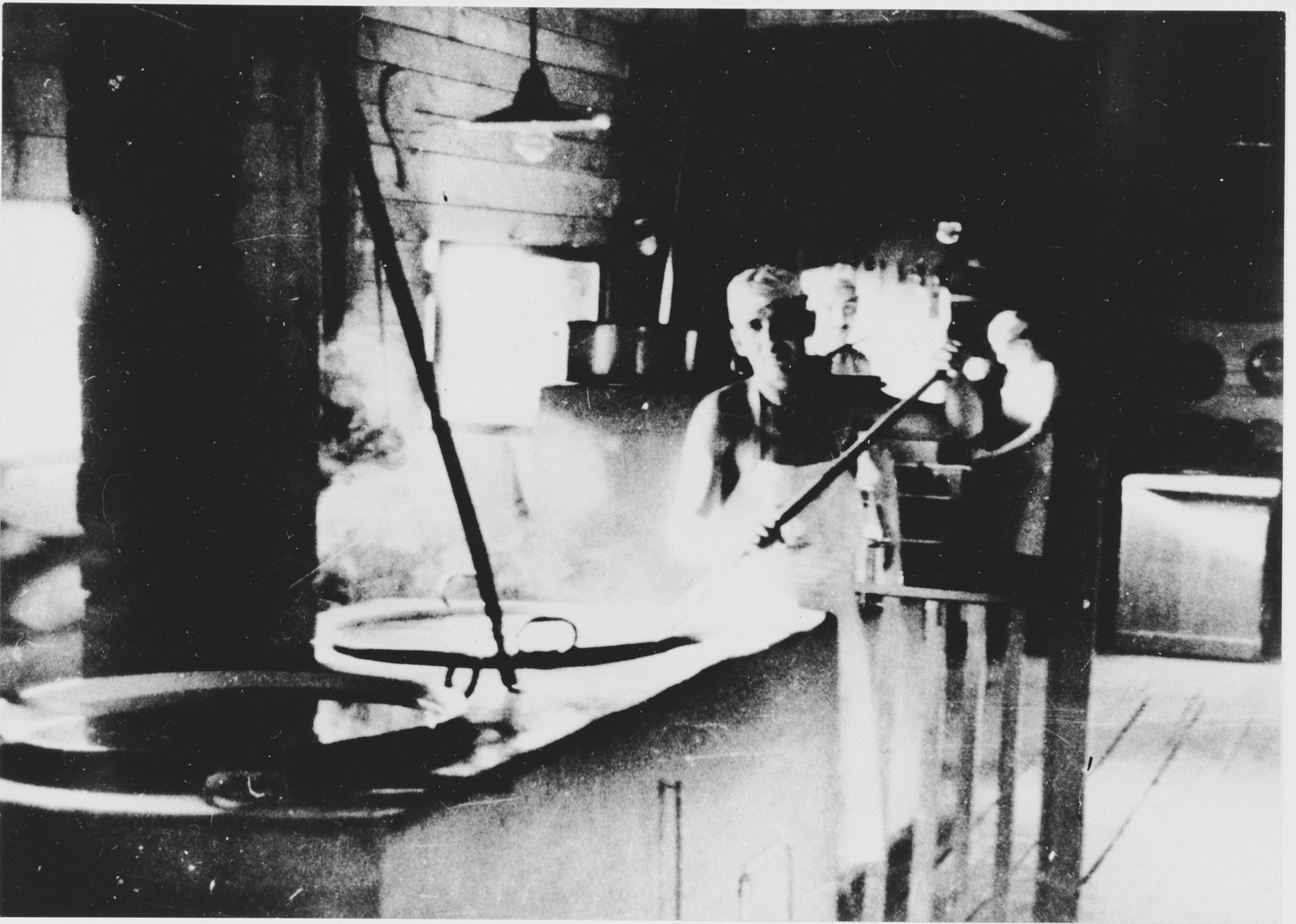 Prisoners labor in the kitchen of the Jasenovac III concentration camp.  This photograph was used for propagandistic purposes by the Ustasa.