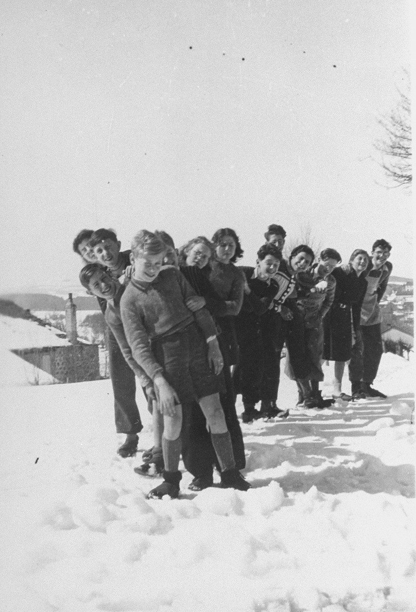 Jewish youth who are living at the La Guespy refugee home in Le Chambon, pose in the snow.  This is one photo from an album presented to Elizabeth Kaufmann prior to her departure from the La Guespy refugee home in Le Chambon-sur-Lignon.    Founded in 1941 by the Secours Suisse aux enfants and run by Juliette Usach, the La Guespy children's home provided shelter to a number of Jewish and non-Jewish refugee children who were living in Le Chambon-sur-Lignon during the Nazi occupation.