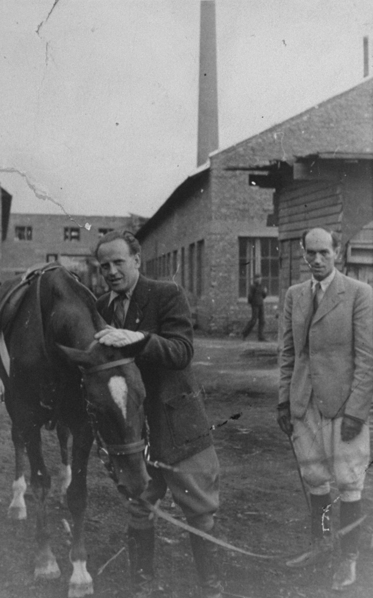 Oskar Schindler with his horse on the grounds of the Emalia enamelworks in Krakow-Zablocie.