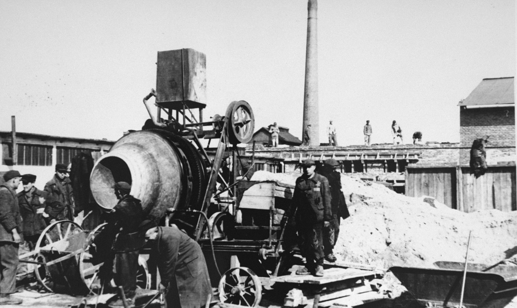 Jewish laborers at work constructing Oskar Schindler's armaments factory in Bruennlitz.