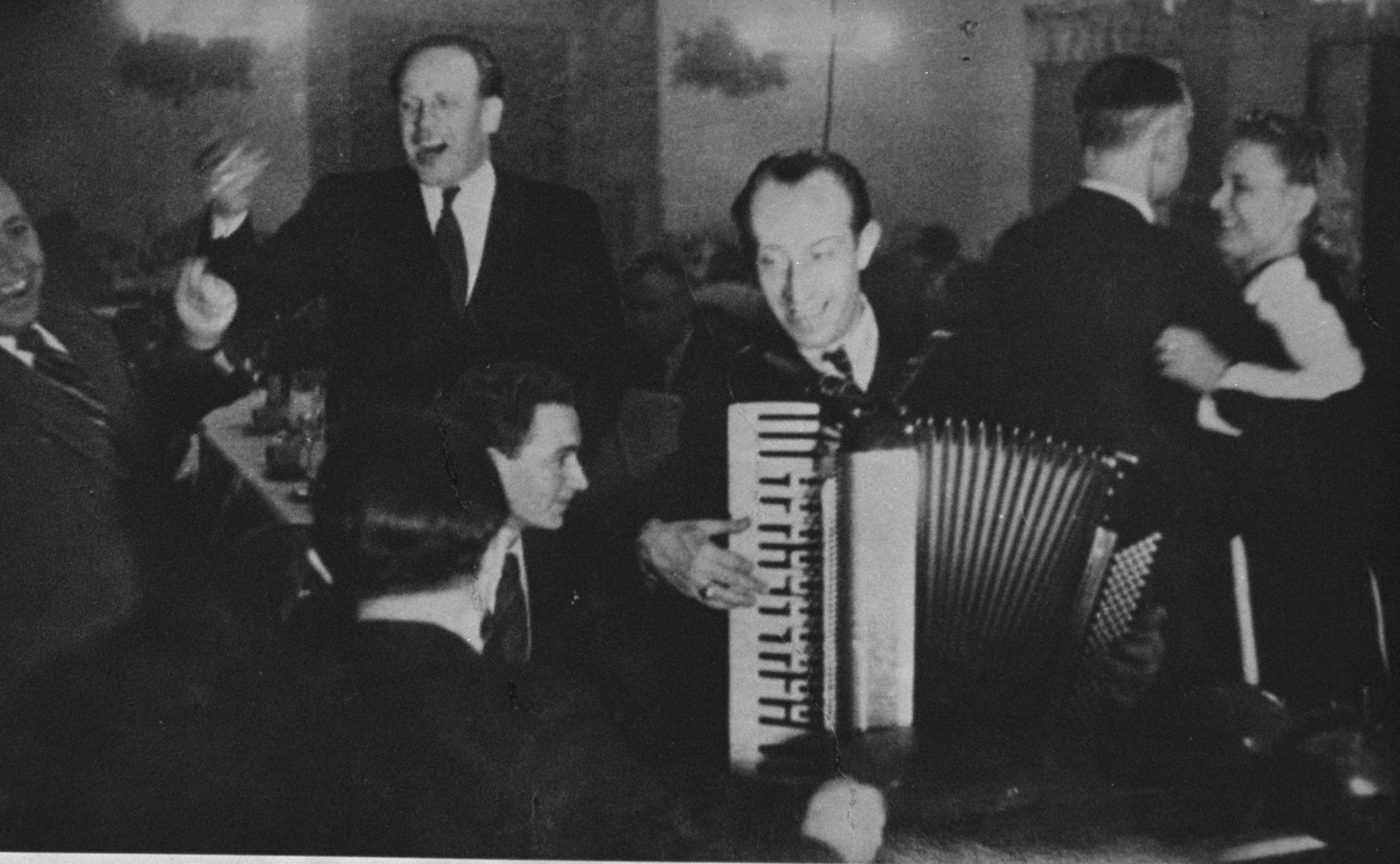 Oskar Schindler at a dinner party in Krakow.  At parties like this, Schindler made contact with various SS and German officials, which often led to tips about impending deportations that enabled him to save his laborers.