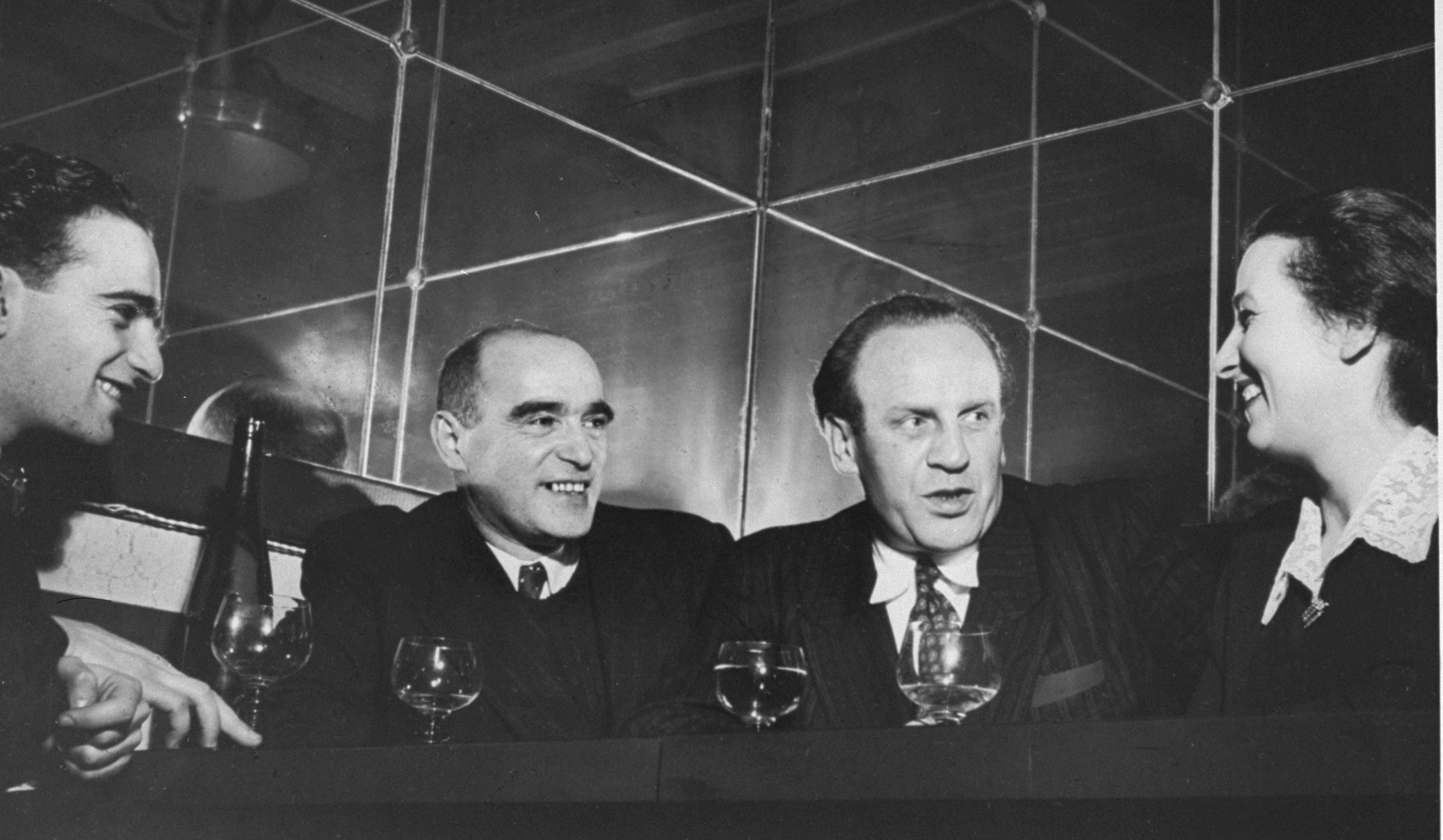"Early in 1949, a group of some 35 ""Schindlerjuden"" gathered privately at Aux Armes de Colmar, an Alsatian restaurant in the north of Paris, to celebrate their friend Oskar Schindler, who was then passing through the city. Itzhak Stern sits next to Oskar Schindler."