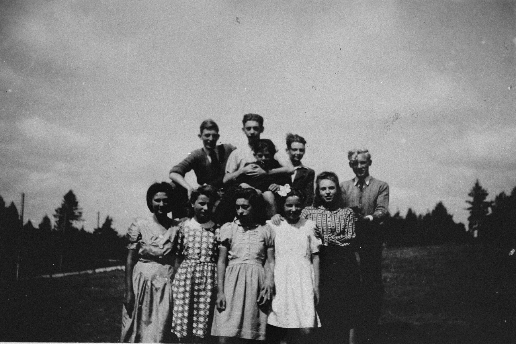 Group portrait of Jewish and non-Jewish refugee children sheltered in various public and private homes in Le Chambon-sur-Lignon during World War II.  Among those pictured are: Antonio Cascarosa (top row, center), a child of Spanish Civil war refugees, Pierre (top row, left), a young deserter from the German army, and an unnamed Czech youth (far right).