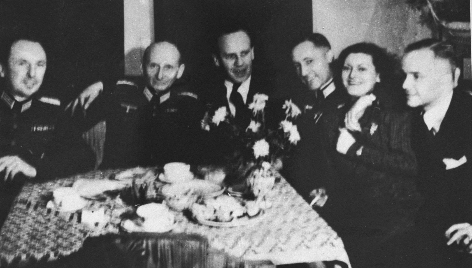 Oskar Schindler (center) enjoys himself at a dinner party in Krakow with German army officers.    At parties like this, Schindler made contact with various SS and German officials, which often led to tips about impending deportations that enabled him to save his laborers.