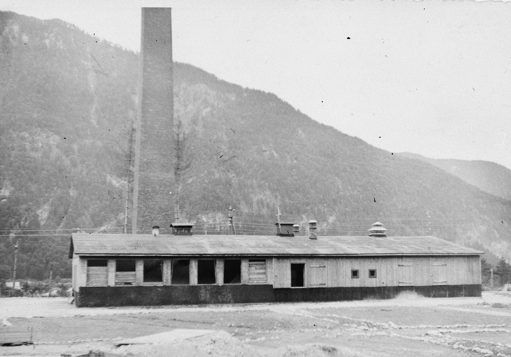 "Exterior view of the crematorium in Ebensee, a sub-camp of Mauthausen.    The original caption reads: ""The old building where the Displaced persons (forced laborers) bodies went back to ashes."""