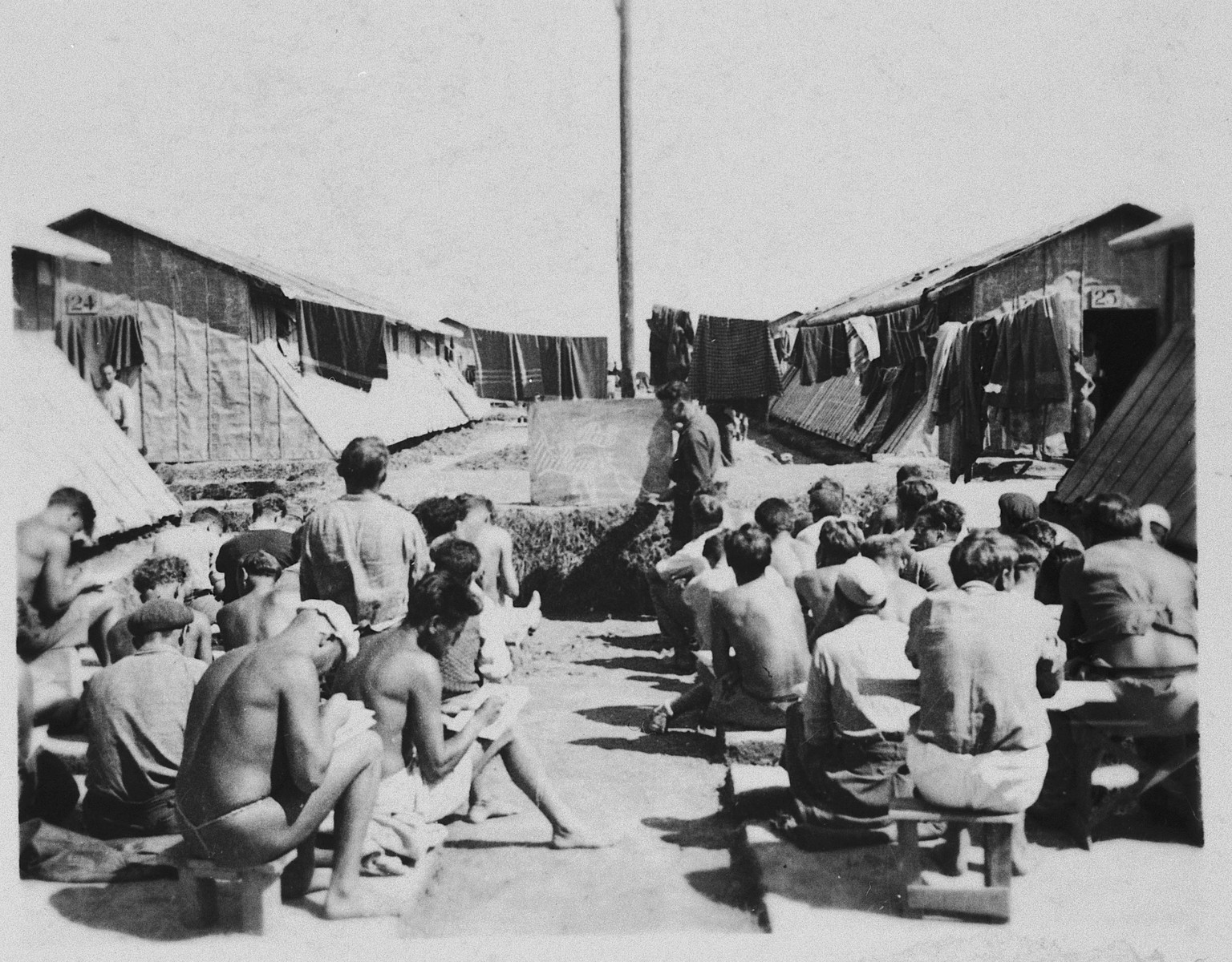 Prisoners gather outside their barracks in the Gurs concentration camp in France.