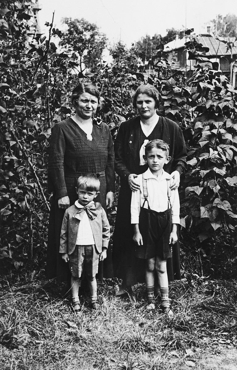Two sisters pose with their respective sons in their parent's home in Borislav.  Bertha and Norbert Bikales are on the left.  Her sister and nephew are on the right.