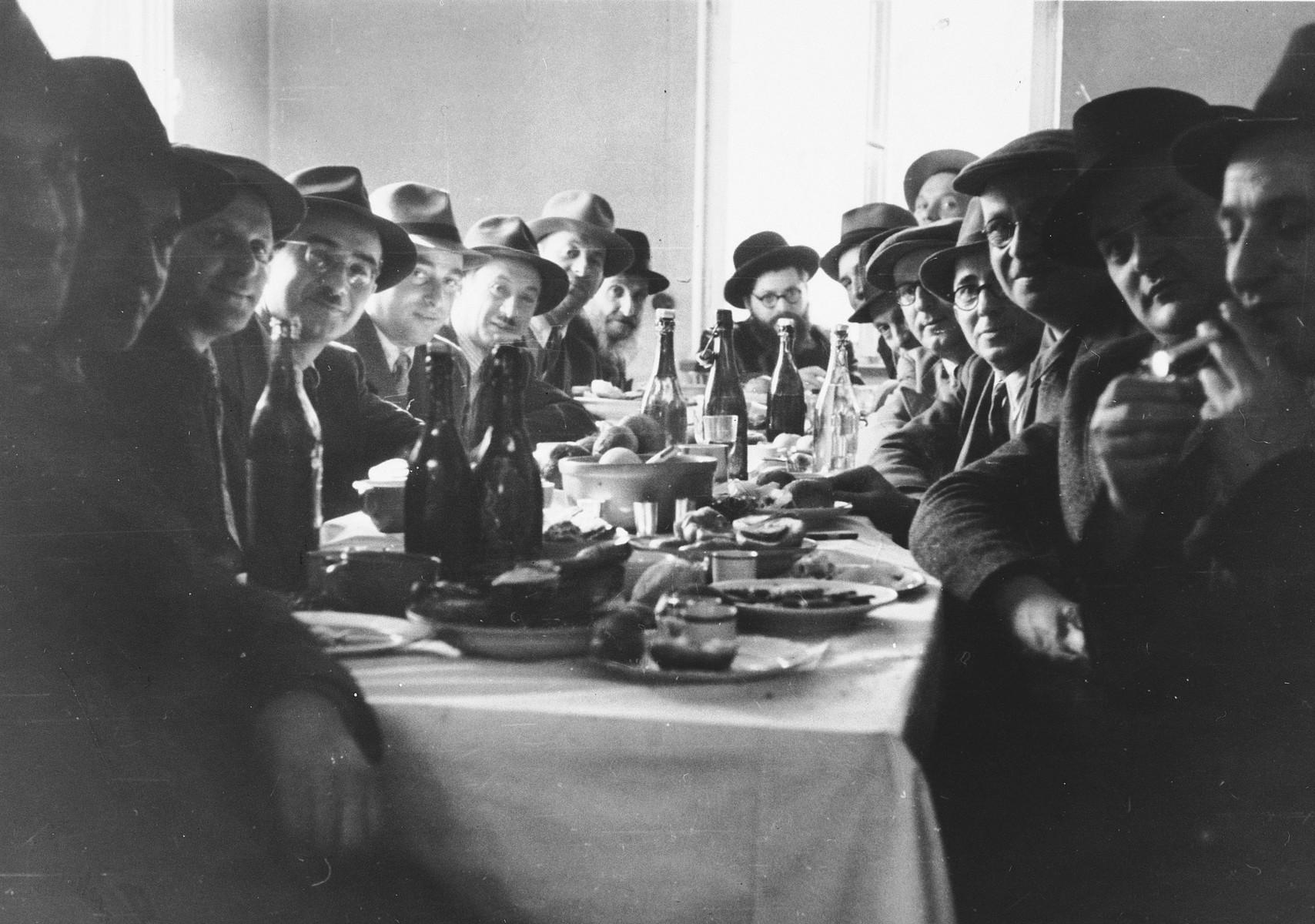 Jewish men celebrate a brit milah (circumcision) in the Wasseralfingen displaced persons' camp.
