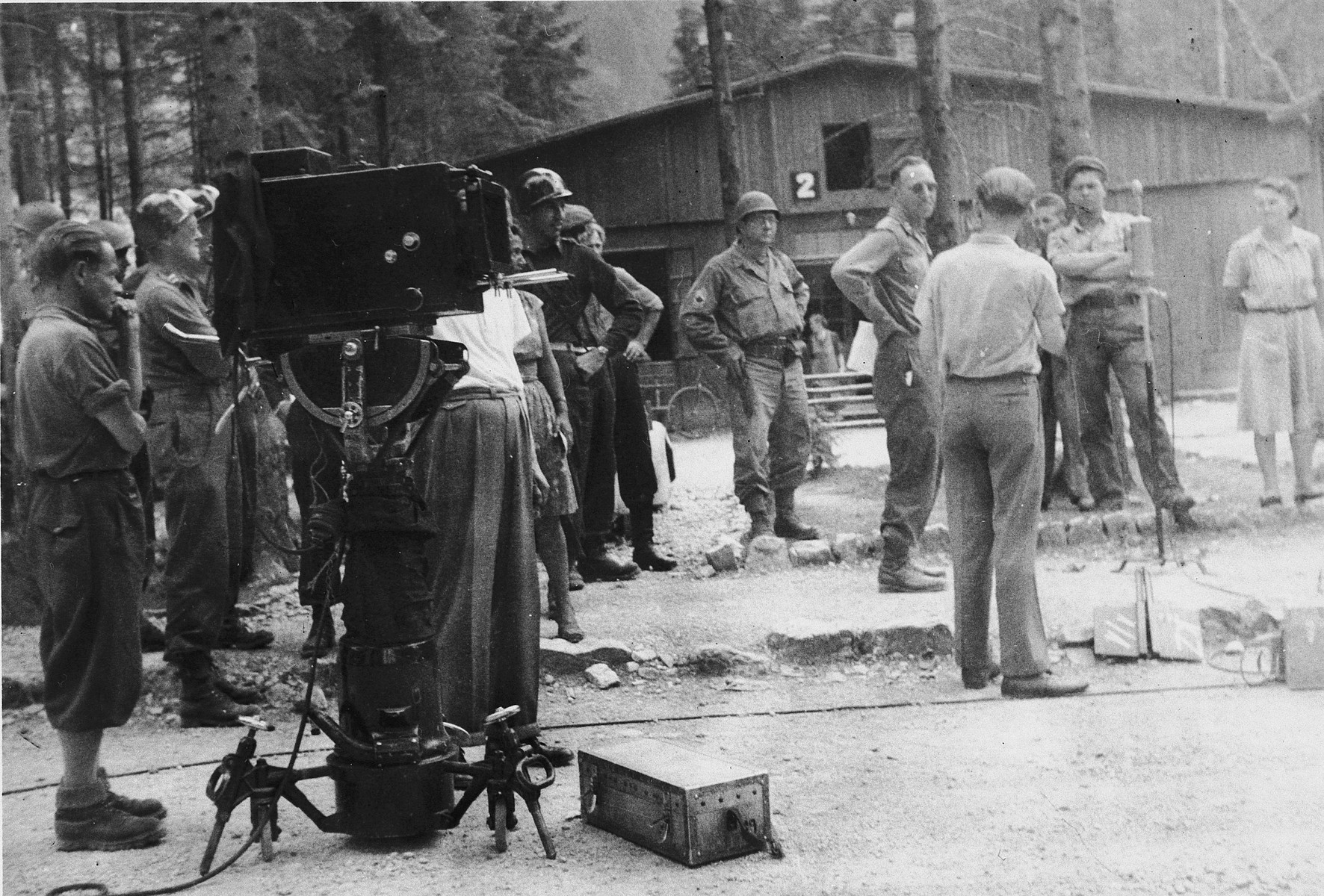 """American servicemen gather documentary evidence of the crimes committed in the Ebensee concentration camp.  The original caption reads: """"Gathering pictures, records, etc. from the displaced persons against the S.S. that ran the camp."""""""