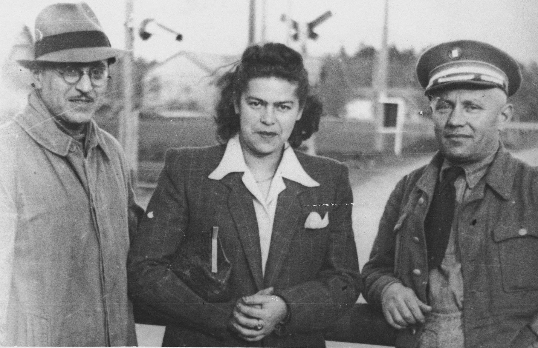 Portrait of three Jewish DPs in the Foehrenwald DP camp.  Yitzhak Baran, head of the Jewish police, is on the far right.