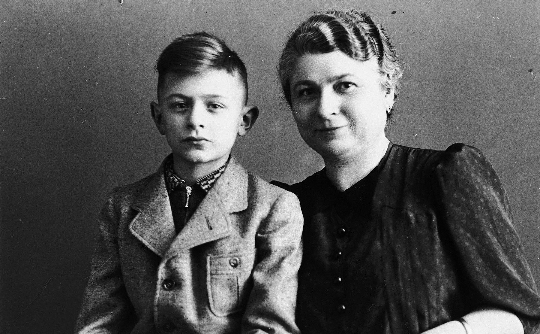 Studio portrait of a young boy, Norbert  Bikales, and his mother Bertha.