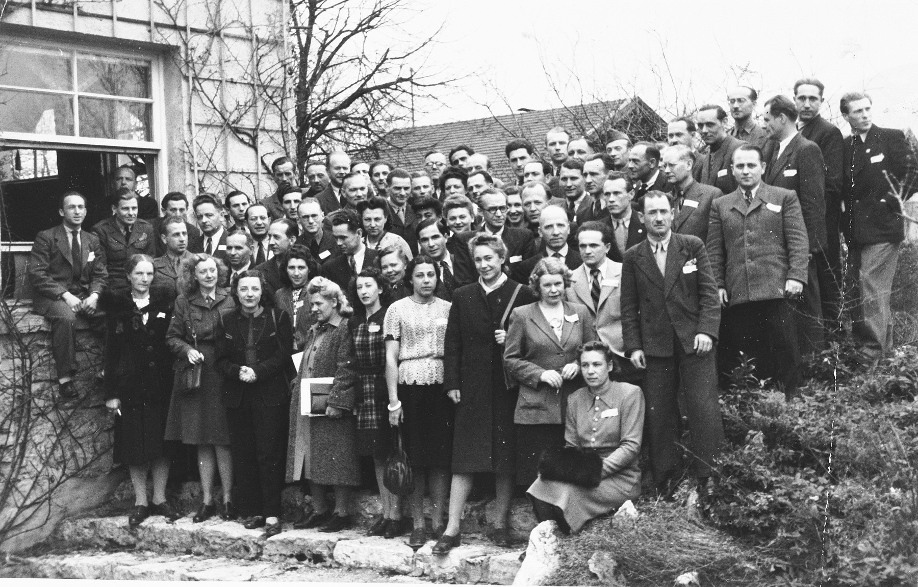 Group portrait of DPs selected to attend a class on American administration in preparation for assuming leadership positions in their camps.  Among those pictured is Natan Slepian (top row).
