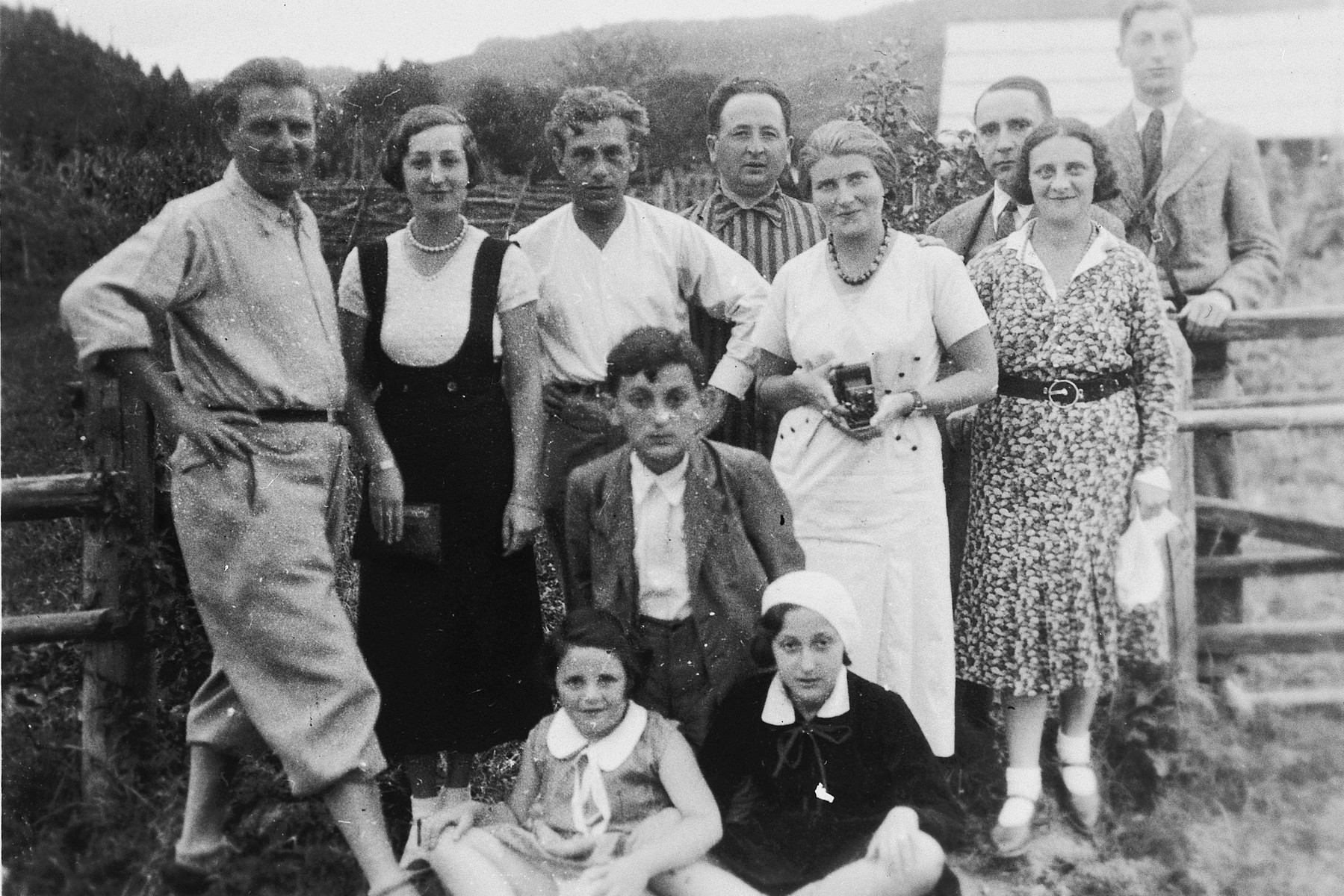 The Kimelman family poses with a group of friends while on vacation.