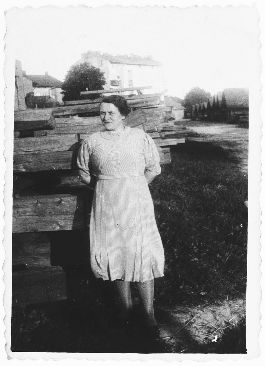 Ida (Jam) Friedberg poses in front of a stack of lumber in the family's lumberyard in Rzeszow, Poland.