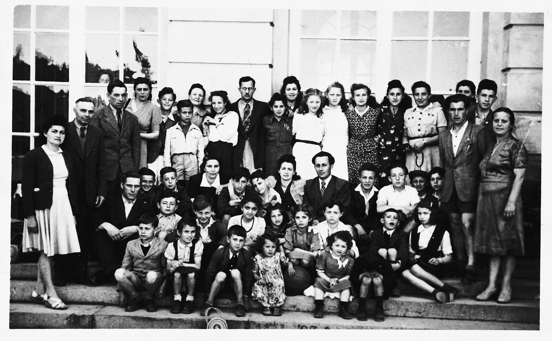Group portrait of children and adults at the Hebrew school in the Gabersee displaced persons camp.  Among those pictured is Bronia Spielman (front row, second from the left).