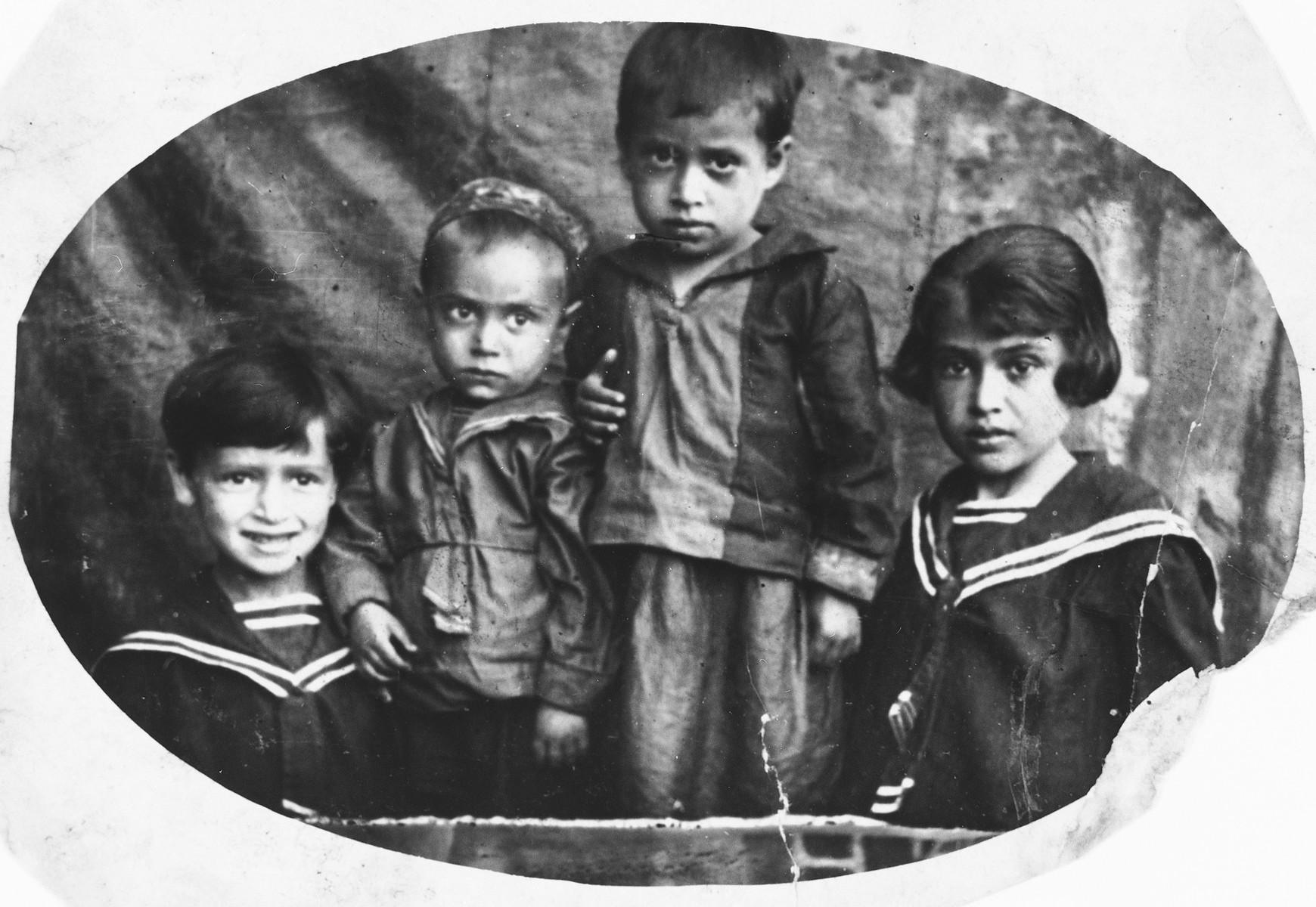 Studio portrait of four Jewish children in Chechersk, Belarus.  Pictured are Maria, Leva, Fanya and Ester Gerchikova.