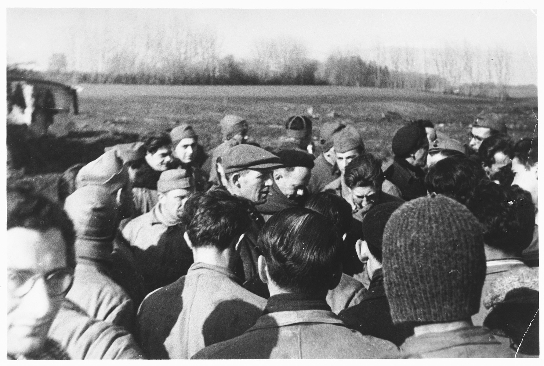 Refugees are assembled in a field at an internment camp in Cossonay, Switzerland.  Most of the internees were Dutch Jews.