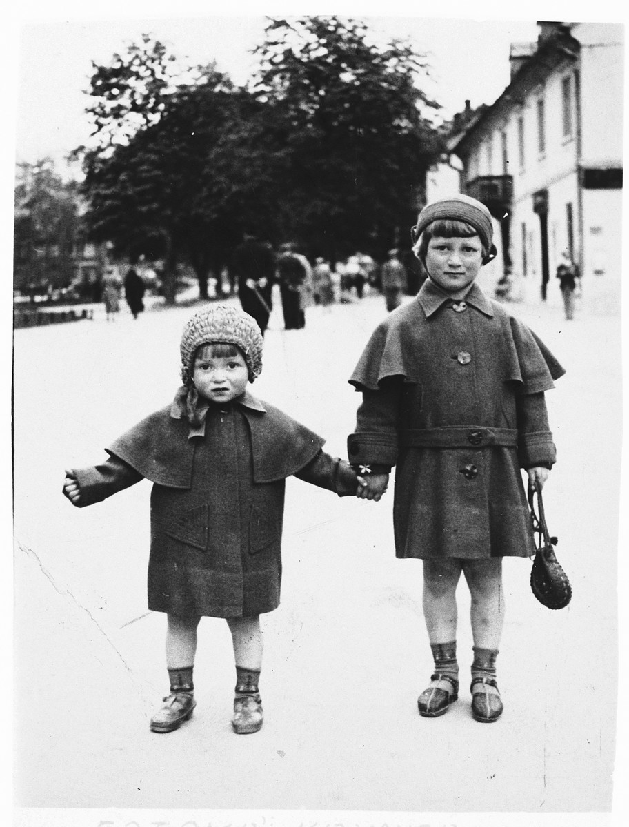 Two Jewish sisters pose on a street in the resort town of Krynica, Poland.  Pictured are Bela and Dola Braunfeld, the nieces of Ida (Jam) Friedberg.