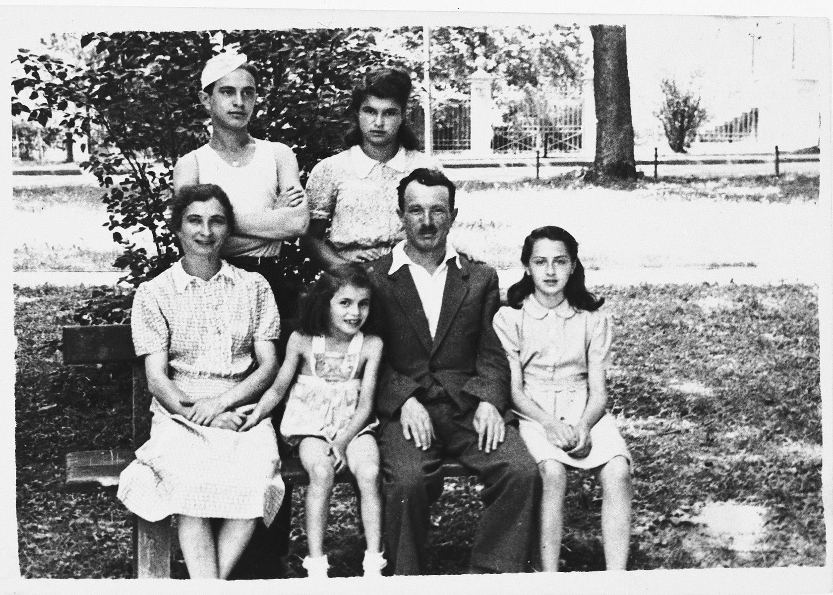 Group portrait of a Jewish DP family in the Gabersee displaced persons camp.  Pictured seated from left to right are: Czarna, Bronia and Simon Spielman and his niece, Miriam Galitzer.  Standing are Arthur and Henia Spielman.