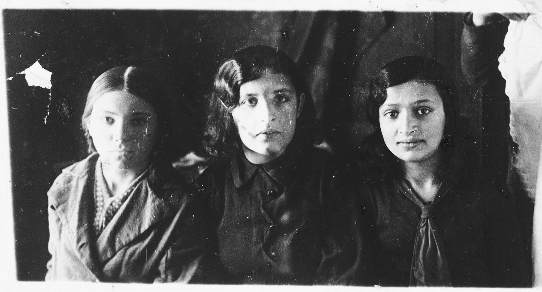 Studio portrait of three Jewish teenage girls in Chechersk, Belarus.  Pictured are Zlata, Chaya and Maria Gerchikova.