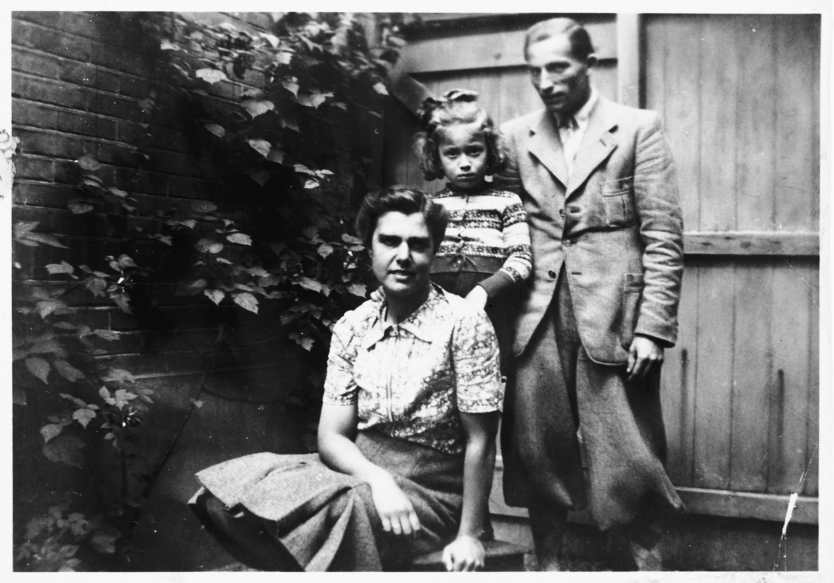 A young Jewish girl poses with the couple who hid her during the German occupation of Holland, prior to leaving their home after the war.  Pictured are Truusje Schoenfeld and her rescuers, Pedro and Truus de Bruin.