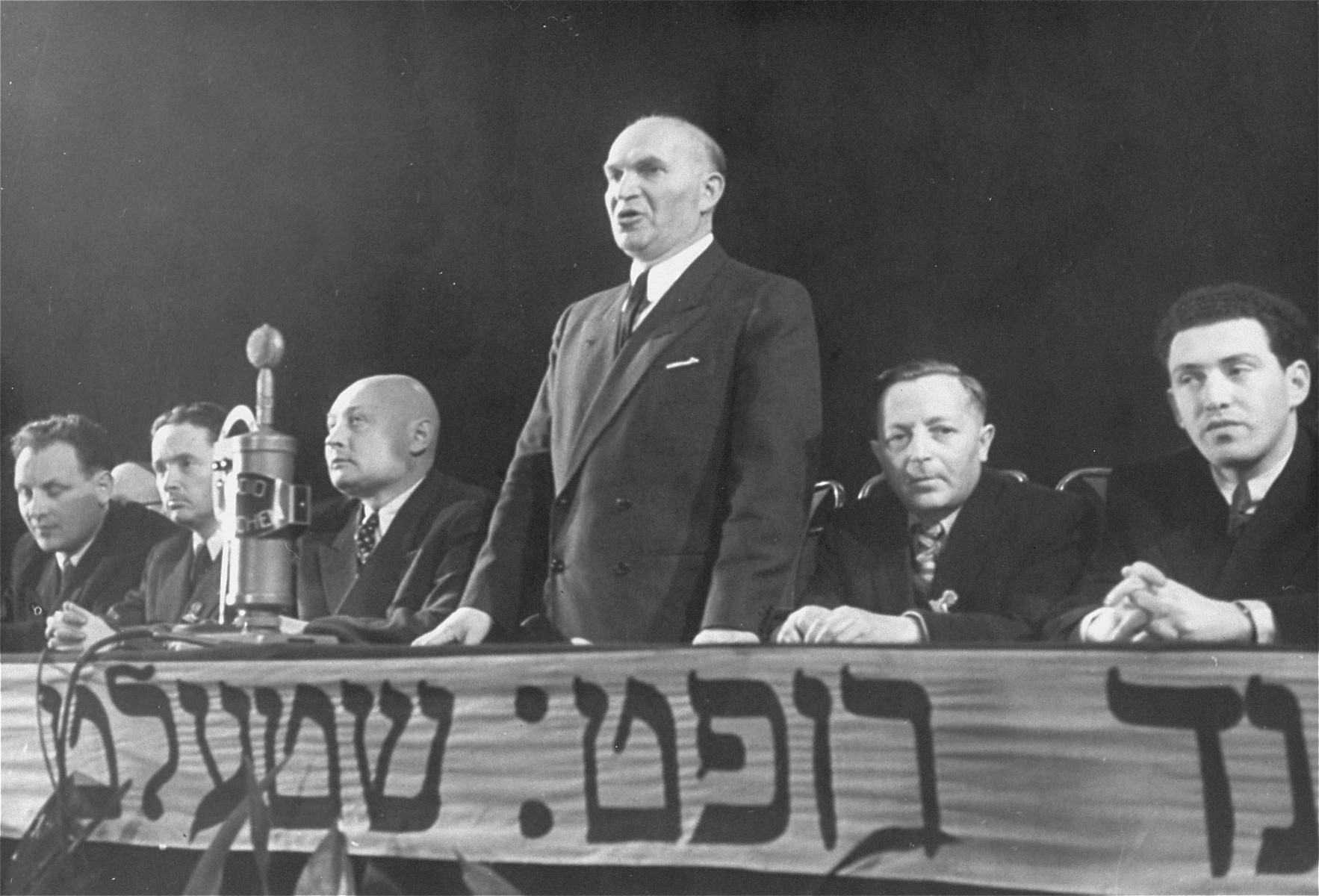 David Treger, chairman of the Central Committee of Liberated Jews in the U.S. Zone of Germany, addresses a post-war Zionist conference in Munich.