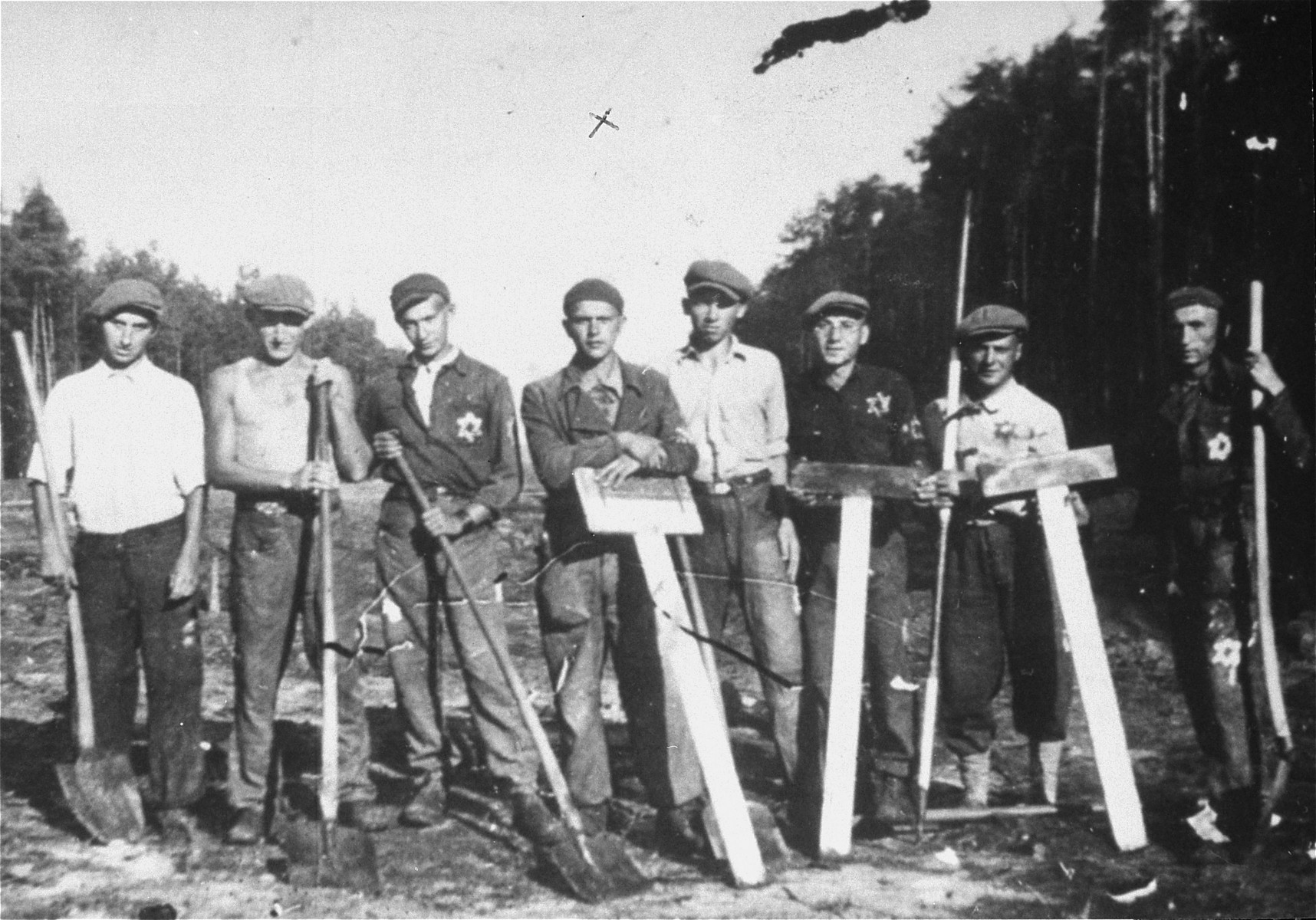 Group portrait Jewish forced laborers who worked on the construction of the autobahn in Geppersdorf, Germany.    Among those pictured is Abram Stone (fourth from the left).