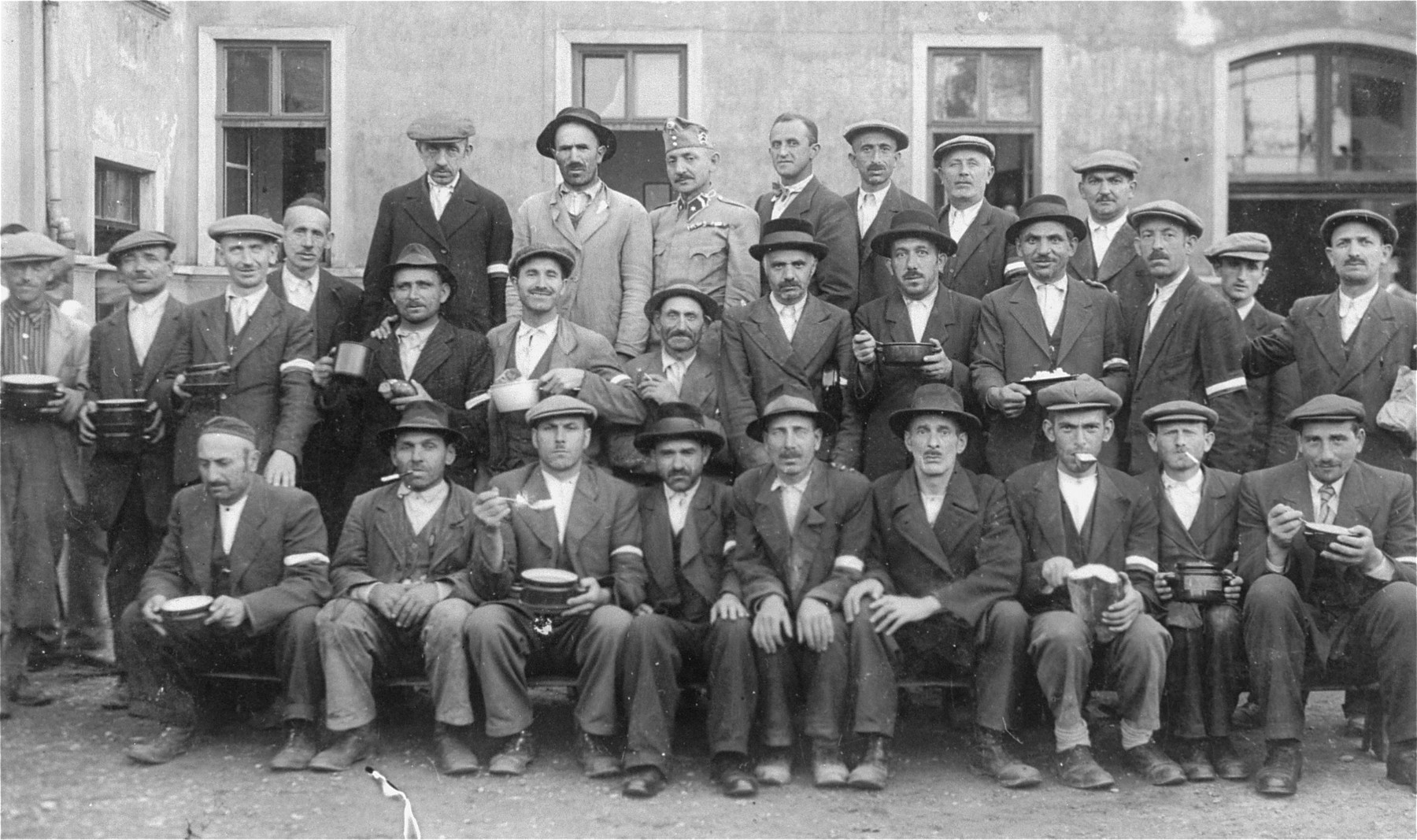 Group portrait of members of an Hungarian Jewish labor battalion in Mukachevo.   Few of these men survived the war.