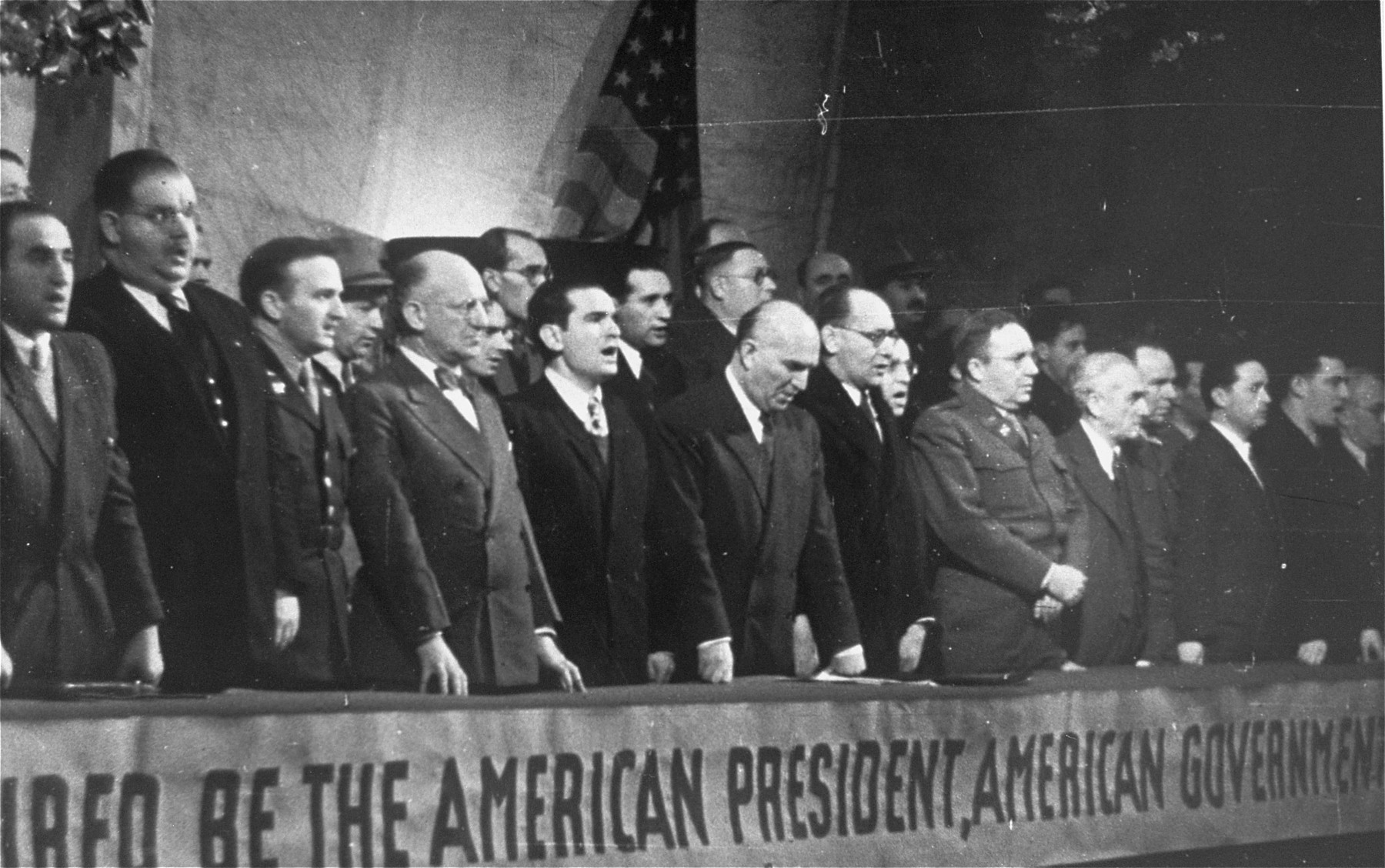Members of the Central Committee of Liberated Jews in the U.S. Zone of Germany attend a meeting in the Prinzregenten Theater celebrating the partition of Palestine.    Among those pictured is Dawid Treger, chairman of the committee (front row center, looking down).